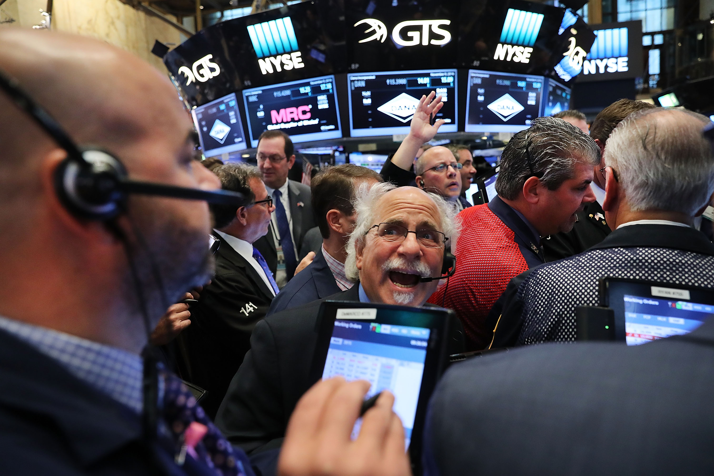 Traders looking surprised on the floor of the NYSE.