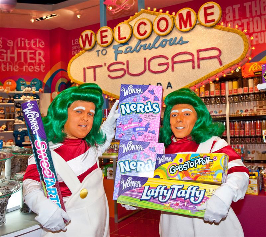 Two Oompah Loompahs hold candy