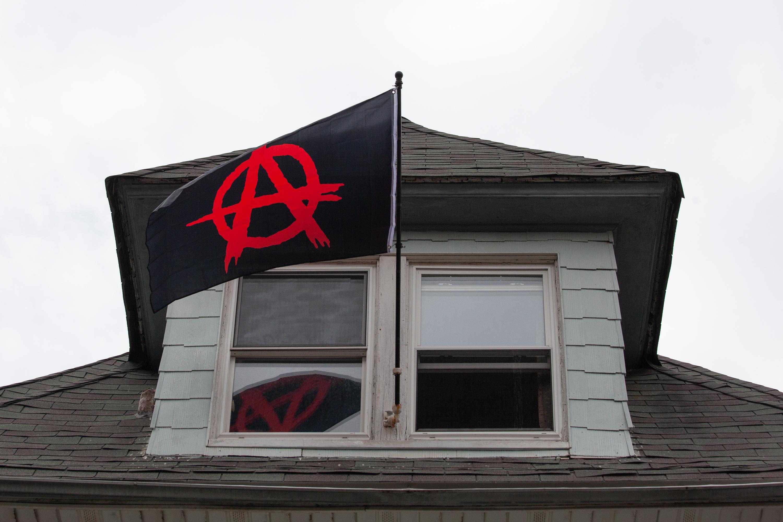 Flatbush, Brooklyn, residents fly an anarchist flag from their window.