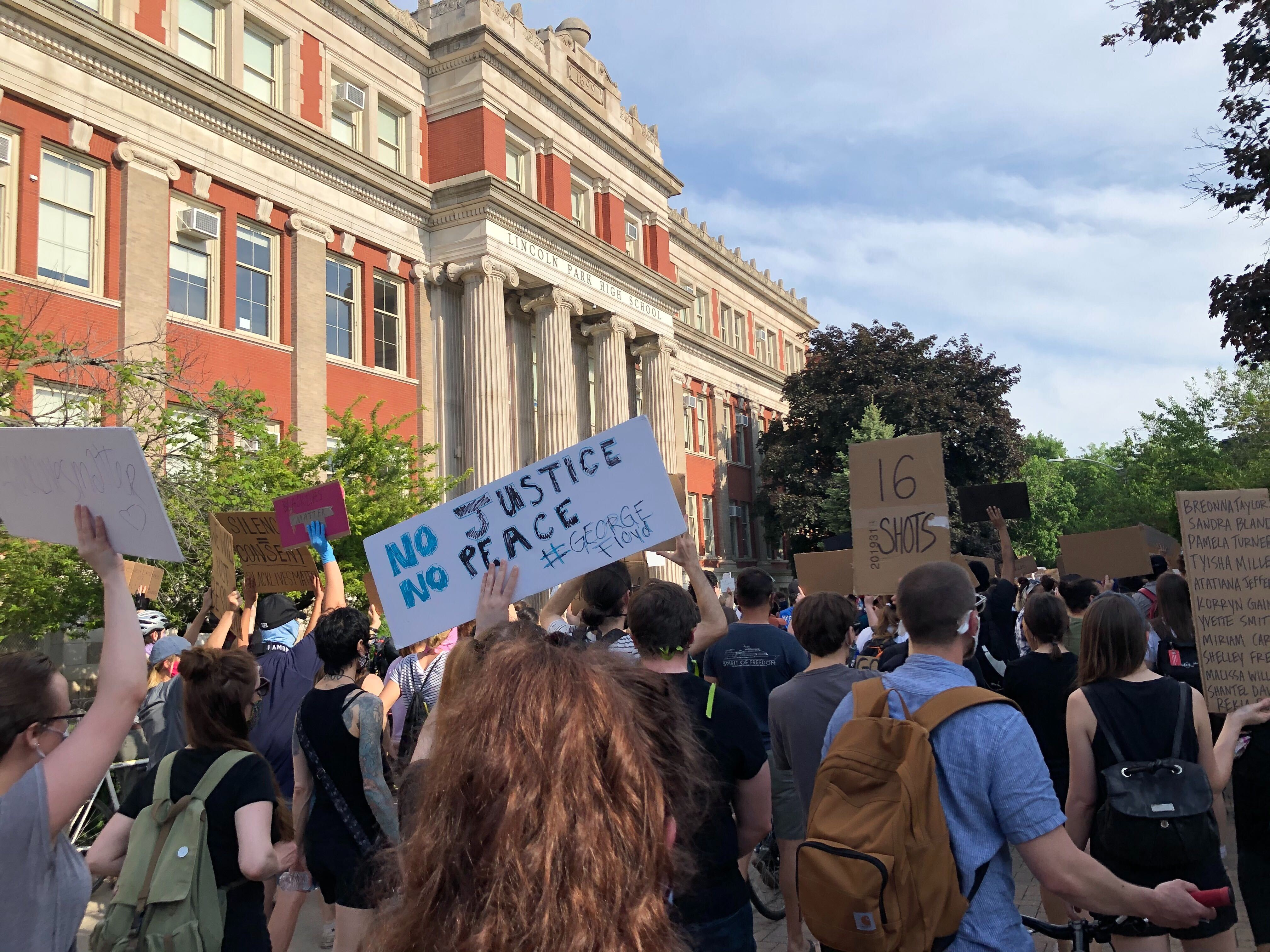Young Chicagoans rally outside Lincoln Park High School in summer 2020.