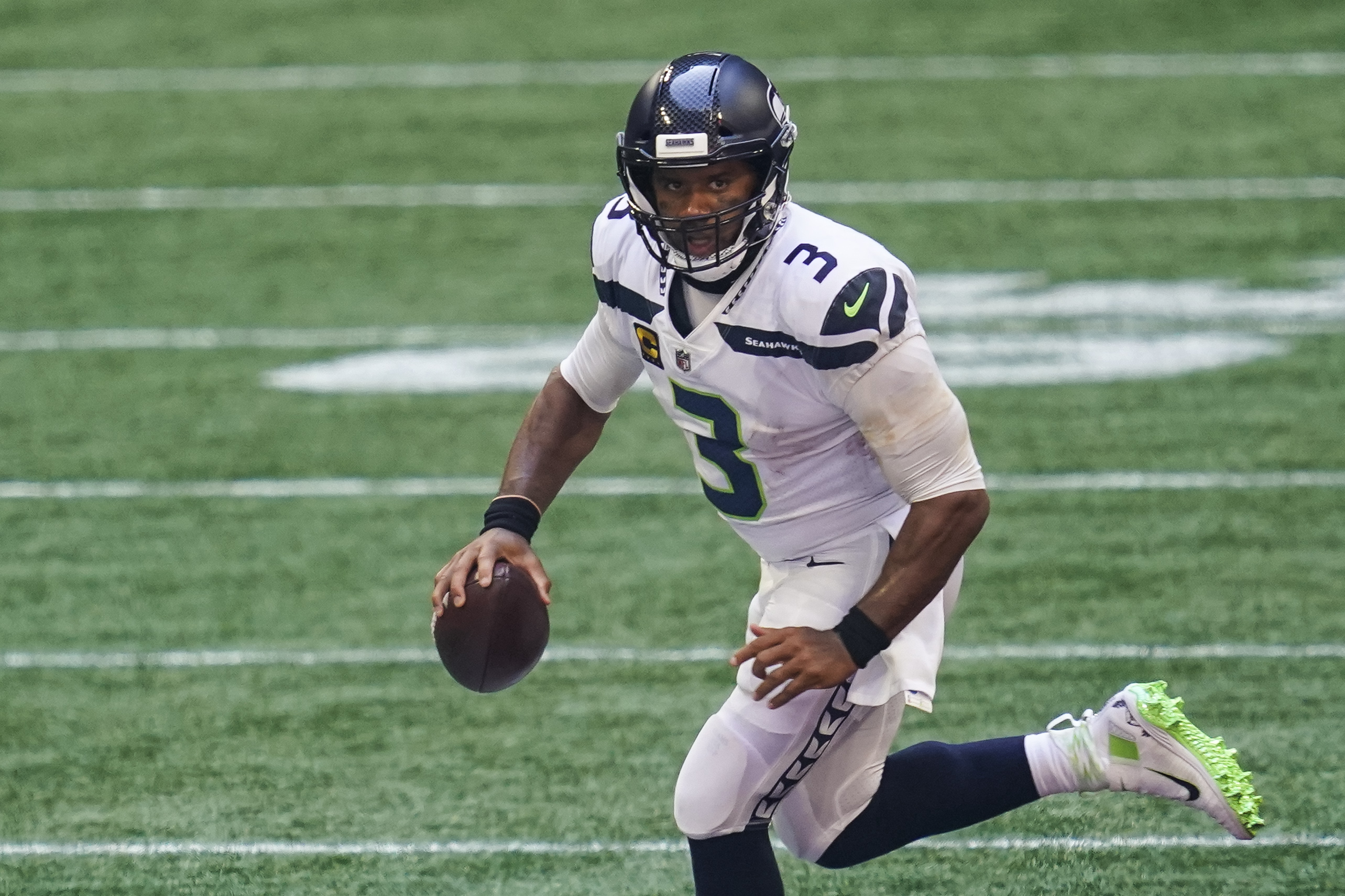 Seattle Seahawks quarterback Russell Wilson runs with the ball against the Atlanta Falcons during the second half at Mercedes-Benz Stadium.