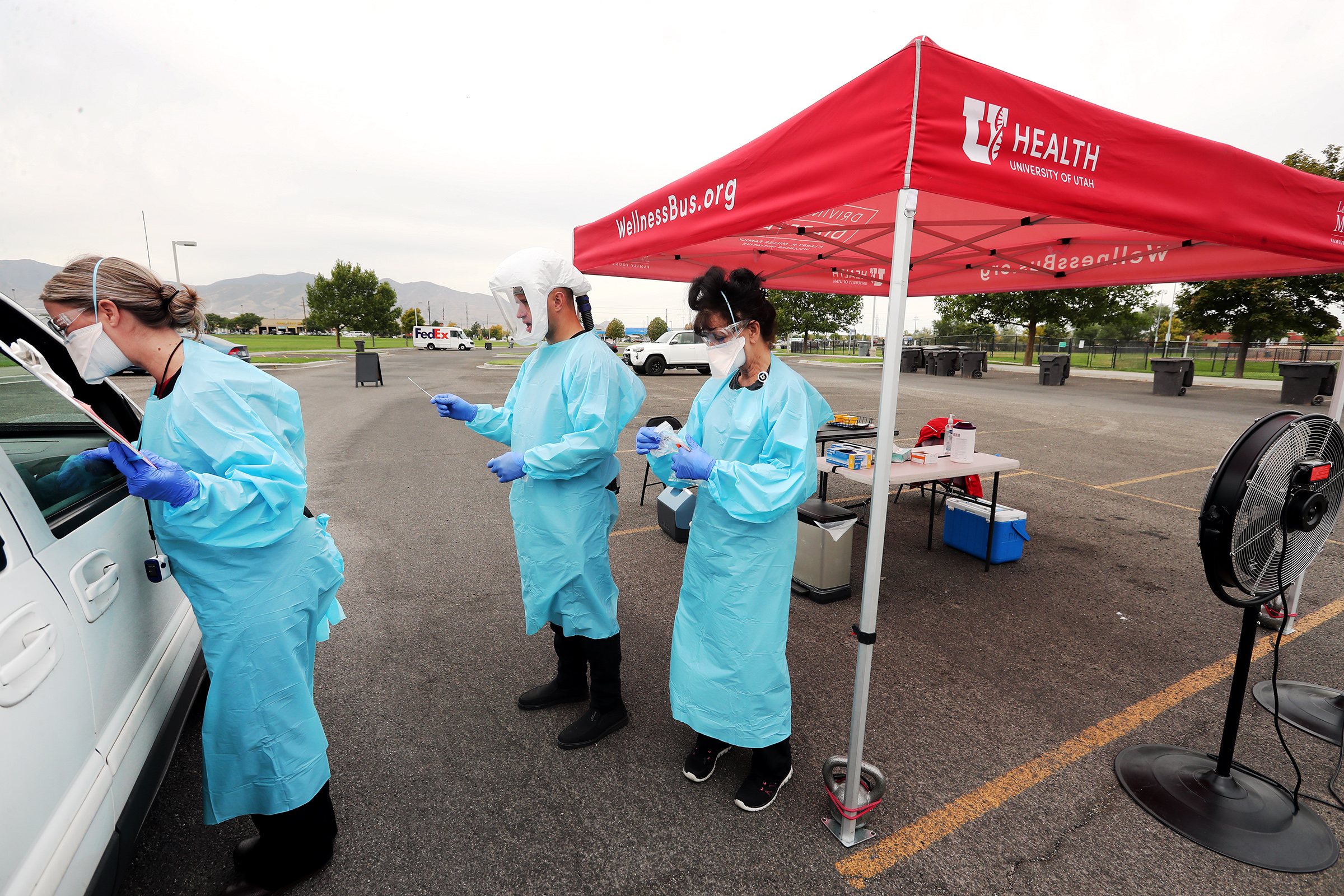Heather Wetch, Caleb Stepaniak and Marina Hays conduct tests as the University of Utah's WellnessBus conducts COVID-19 testing at West Valley City's Centennial Park on Monday, Aug. 31, 2020.