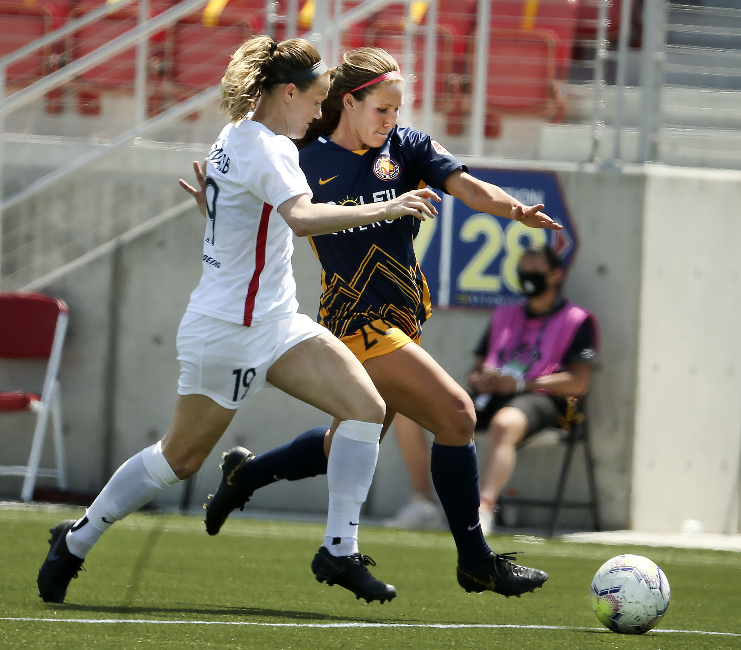 OL Reign player Kristen McNabb (19) and Utah Royals player Mallory Weber (20) compete for the ball in a 2020 NWSL Challenge Cup game at Zions Bank Stadium in Herriman on Wednesday, July 8, 2020.