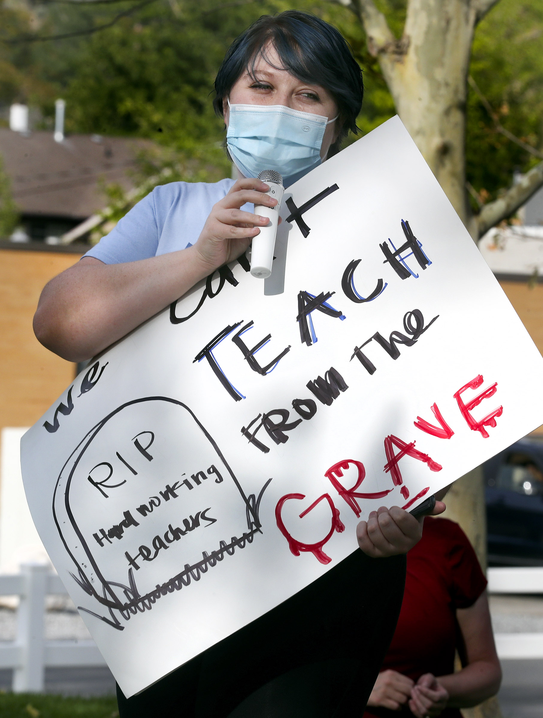 Brittany Goddard, a second grade teacher at Bountiful Elementary School, talks about teachers safety with students in the classroom during the COVID-19 pandemic during a rally in support of schoolteachers, staff and students outside of the Davis School District offices in Farmington on Friday, Sept. 25, 2020.