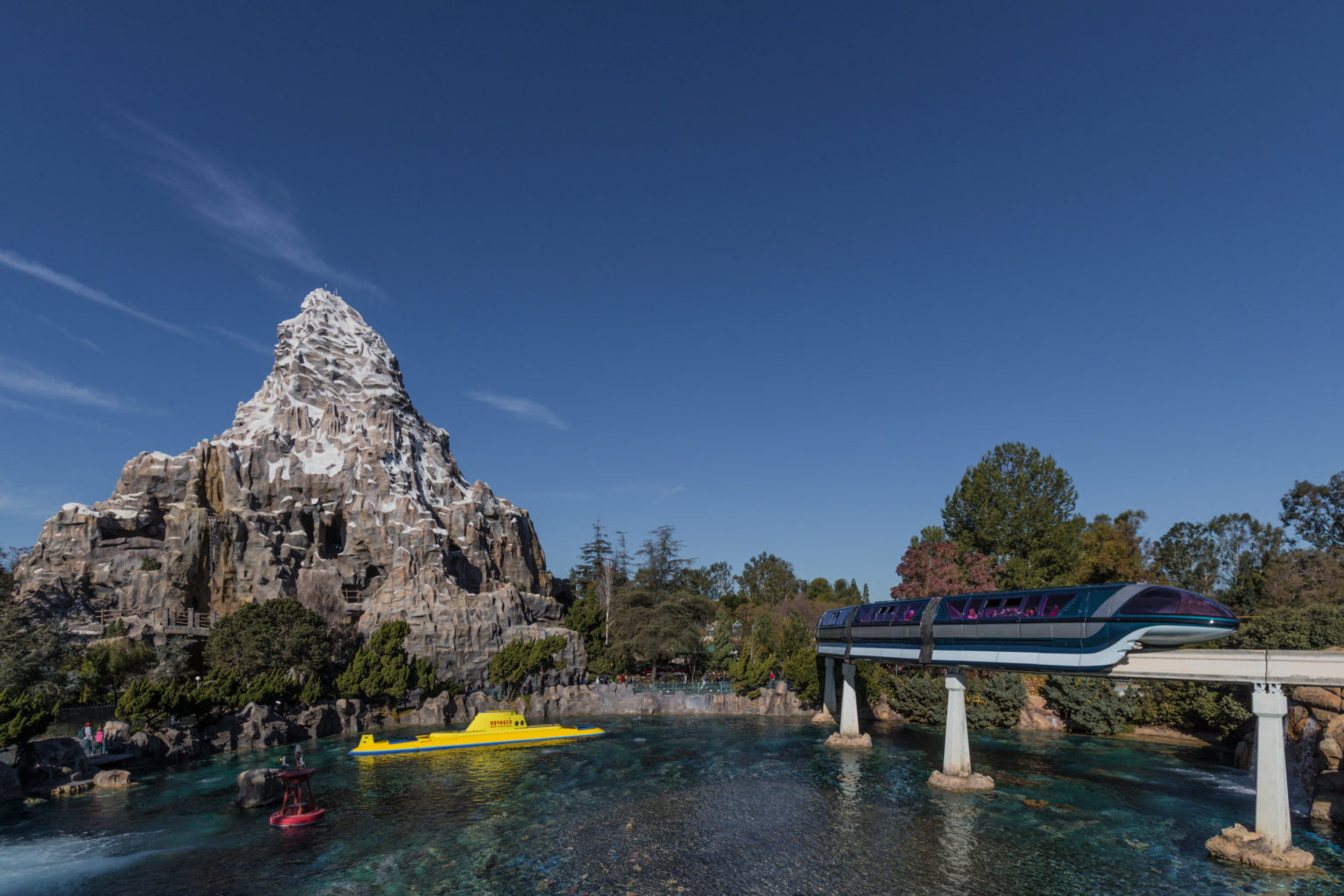 Three of the most popular attractions at Disneyland - the Matterhorn Bobsleds, Finding Nemo Submarine Voyage and Disneyland Monorail.