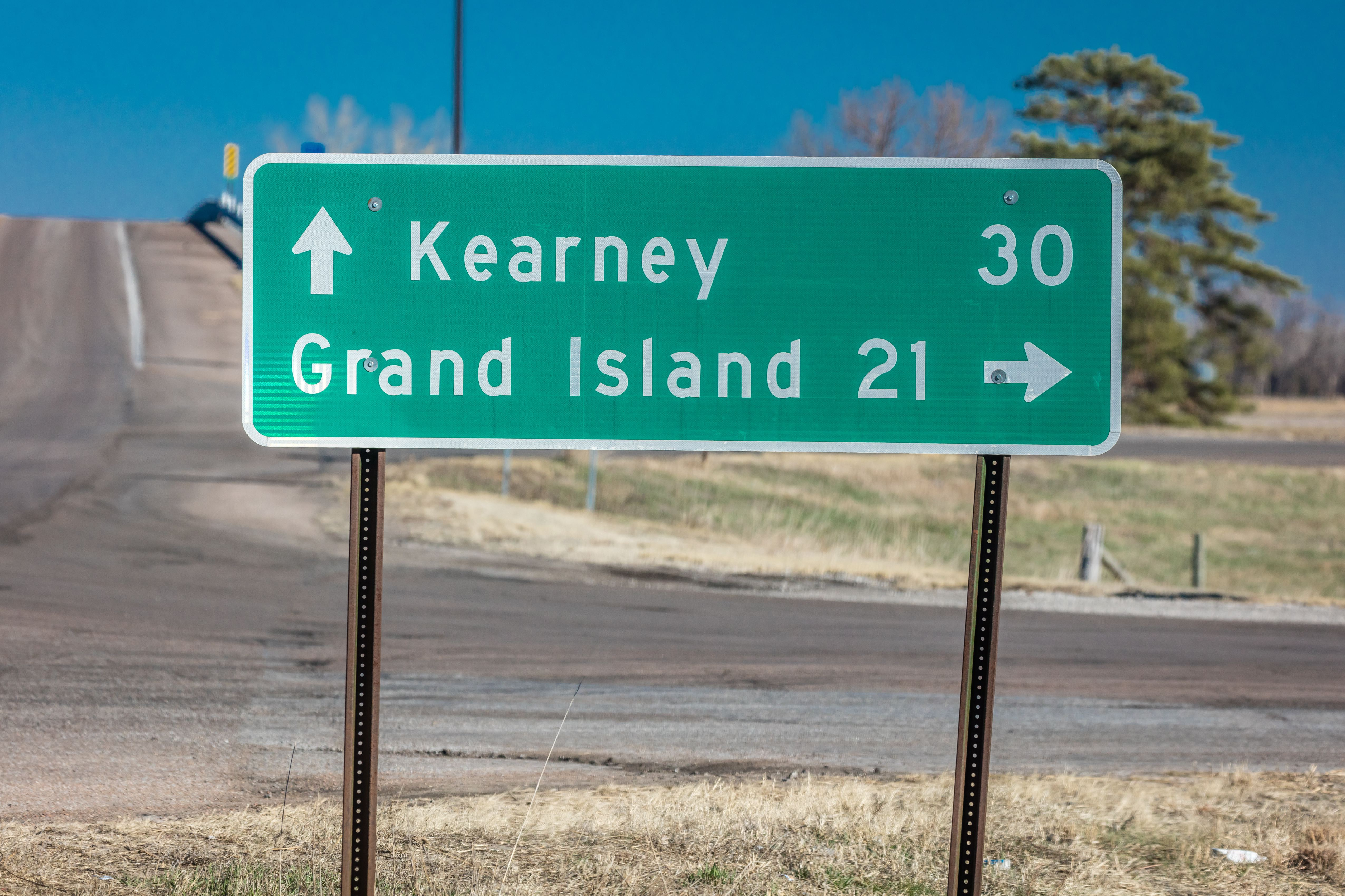 Sign pointing to Kearney and Grand Island Nebraska - Midwestern America, along Interstate Highway 80