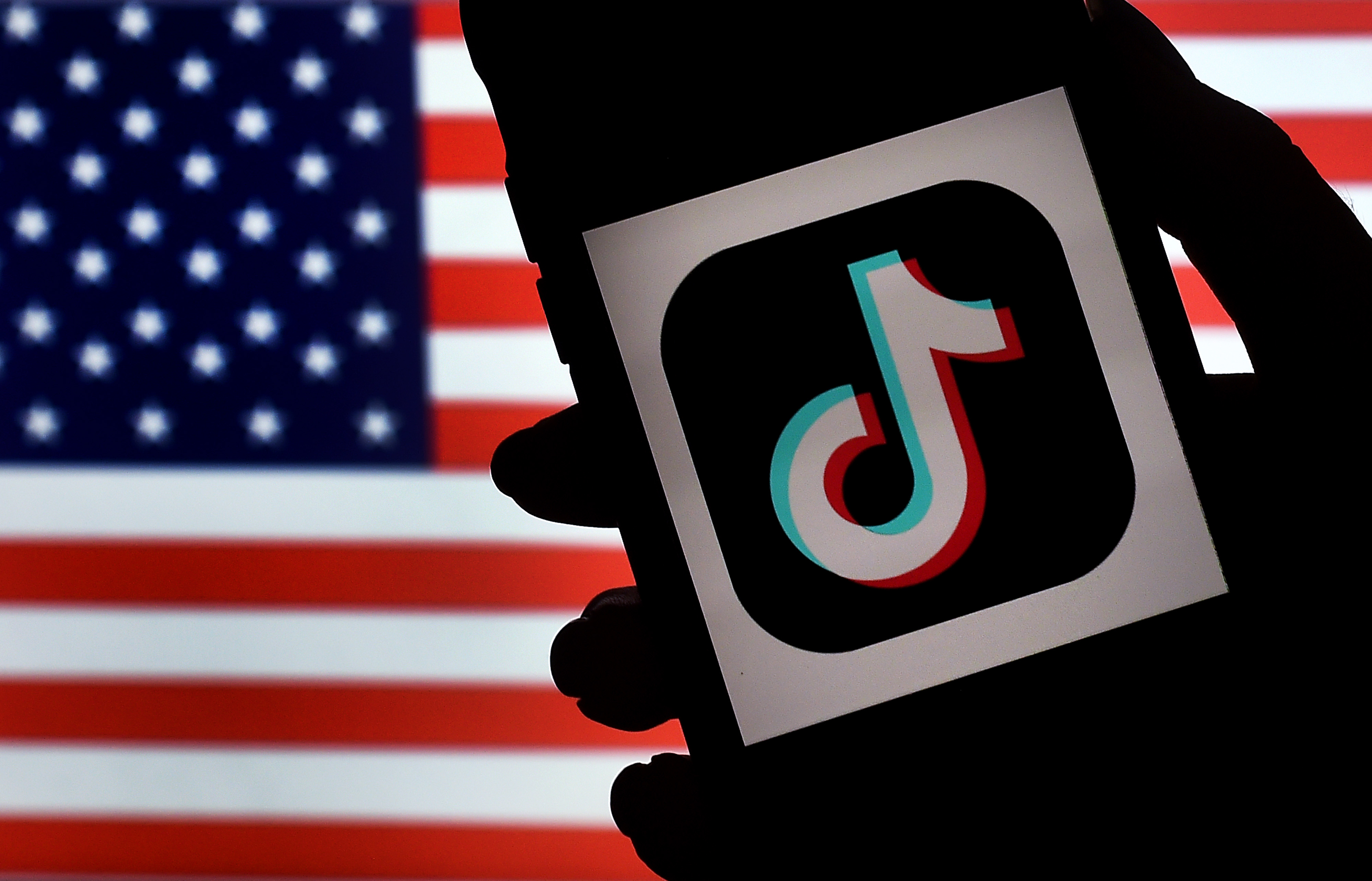 A federal judge on Sunday postponed a Trump administration order that would have banned the popular video sharing app TikTok from U.S. smartphone app stores around midnight.
