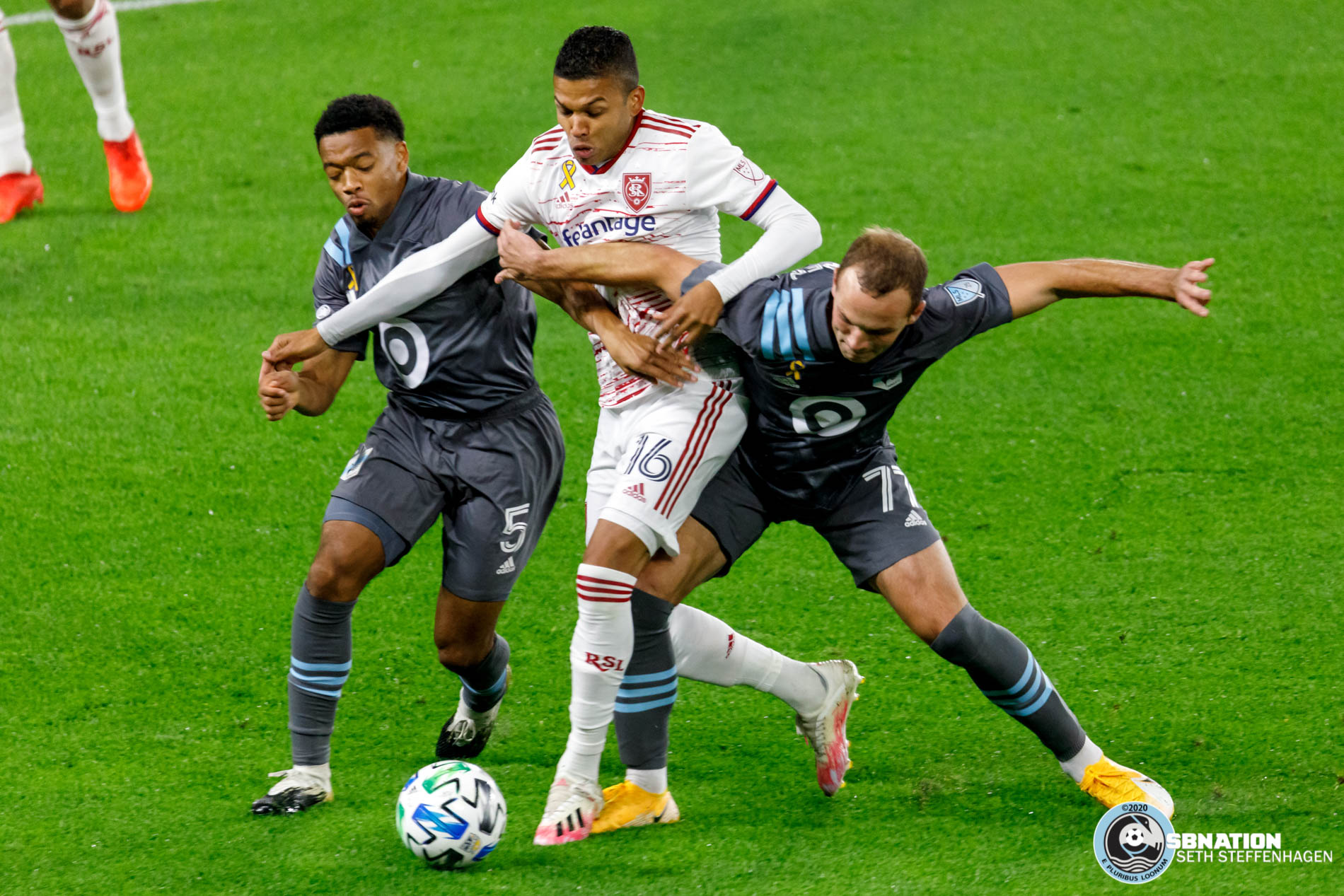 September 27, 2020 - Saint Paul, Minnesota, United States - Minnesota United players Jacori Hayes (5) and Chase Gasper (77) fight Real Salt Lake midfielder Maikel Chang (16) for the ball during the match at Allianz Field.   (Photo by Seth Steffenhagen/Steffenhagen Photography)