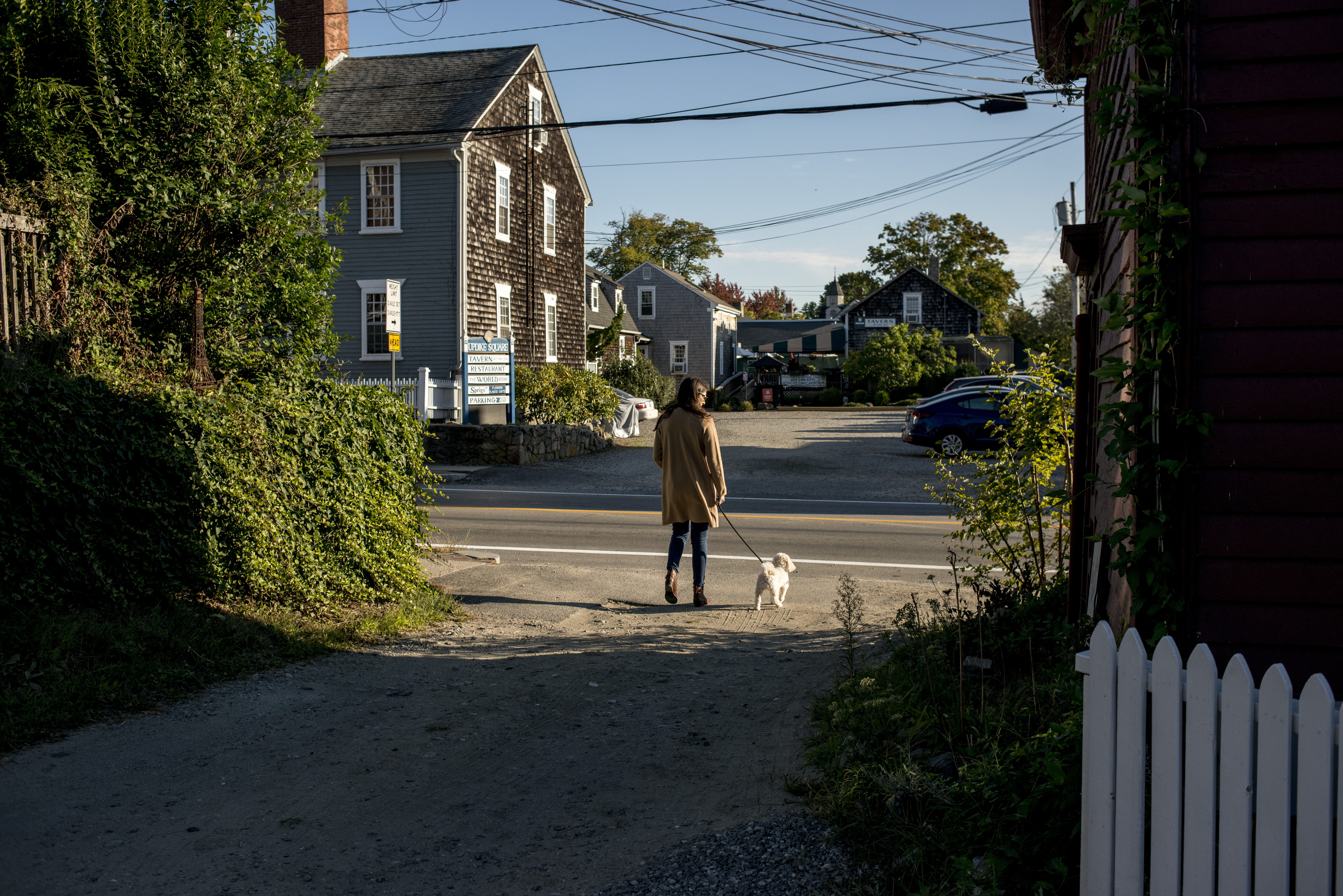 Tori Perrotti walks her dog in downtown Wickford, Rhode Island, on Sunday, Sept. 20, 2020. Perrotti says she was the subject of an attempted internet shaming by David Leavitt after she refused to sell him an electronic toothbrush at Target, mislabeled for a fraction of the selling price. The majority of the online community took Perrotti's side, raising over $30,000 through a GoFundMe page.