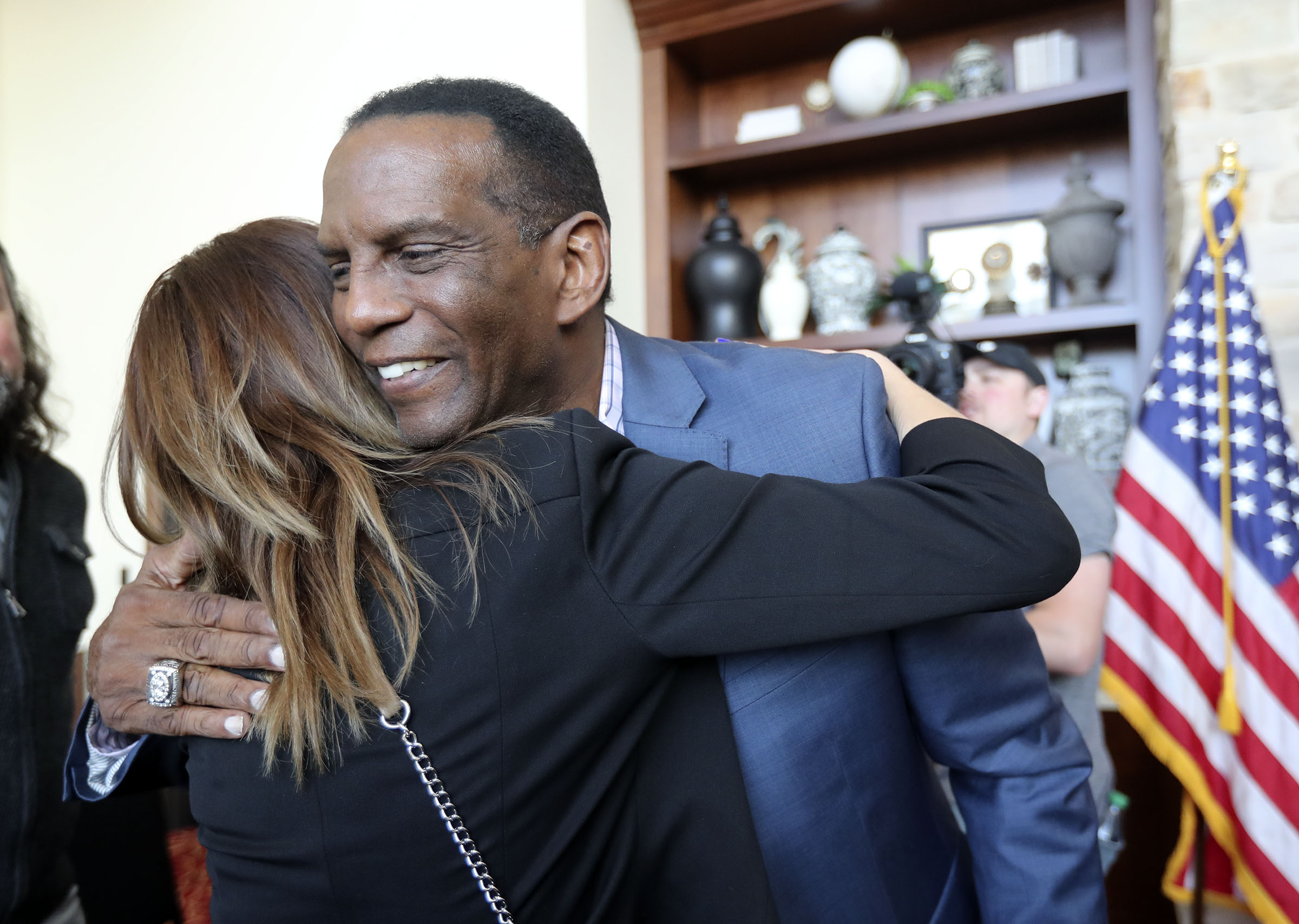 Republican Burgess Owens hugs Melissa Moss before announcing his run against Rep. Ben McAdams, D-Utah, in the 4th Congressional District during a campaign launch event at Hale Centre Theatre in Sandy on Wednesday, Nov. 6, 2019.