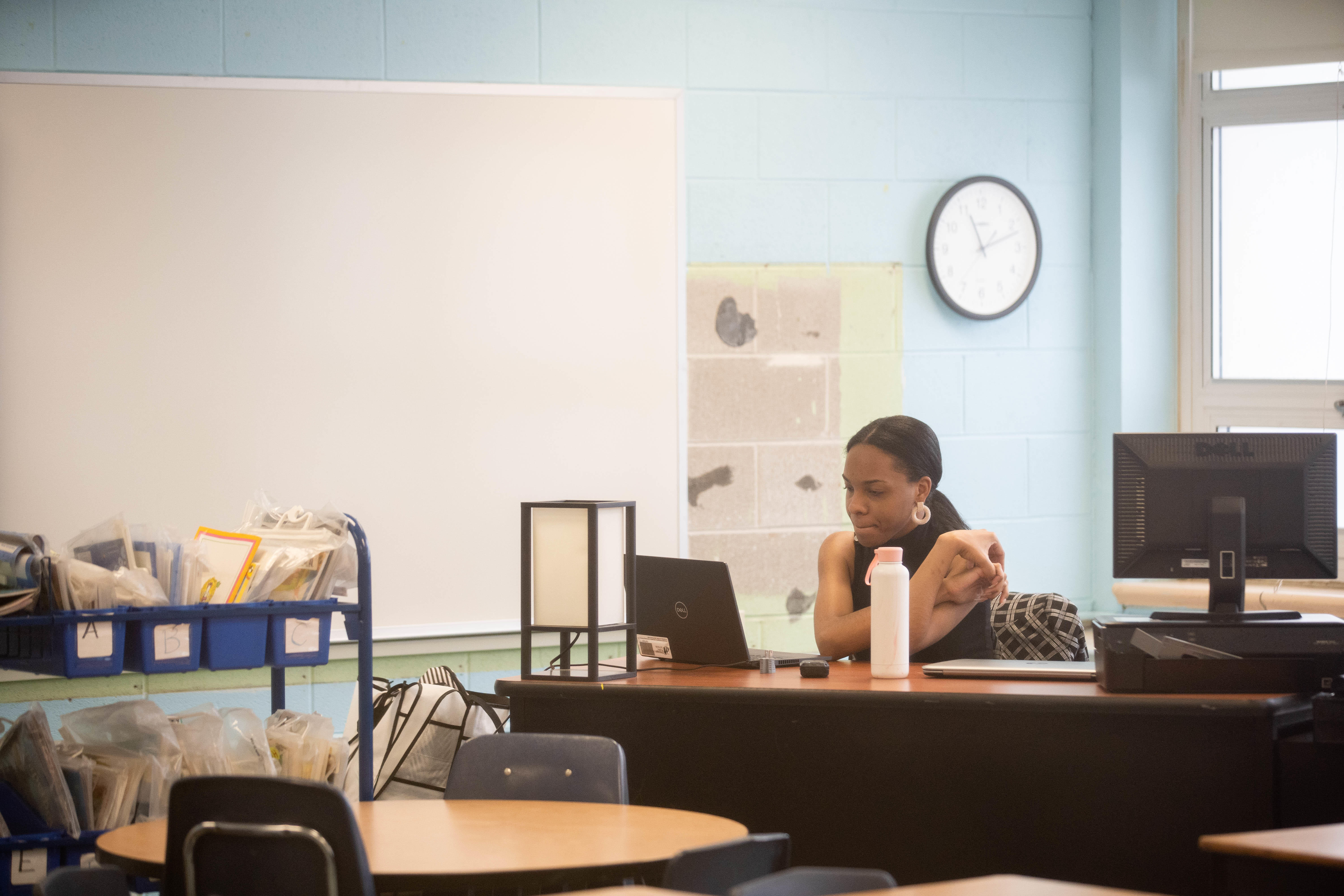 A teacher looks at her laptop at Dr. Martin Luther King, Junior Academy of Social Justice in Englewood on the first day back to school, Tuesday morning.