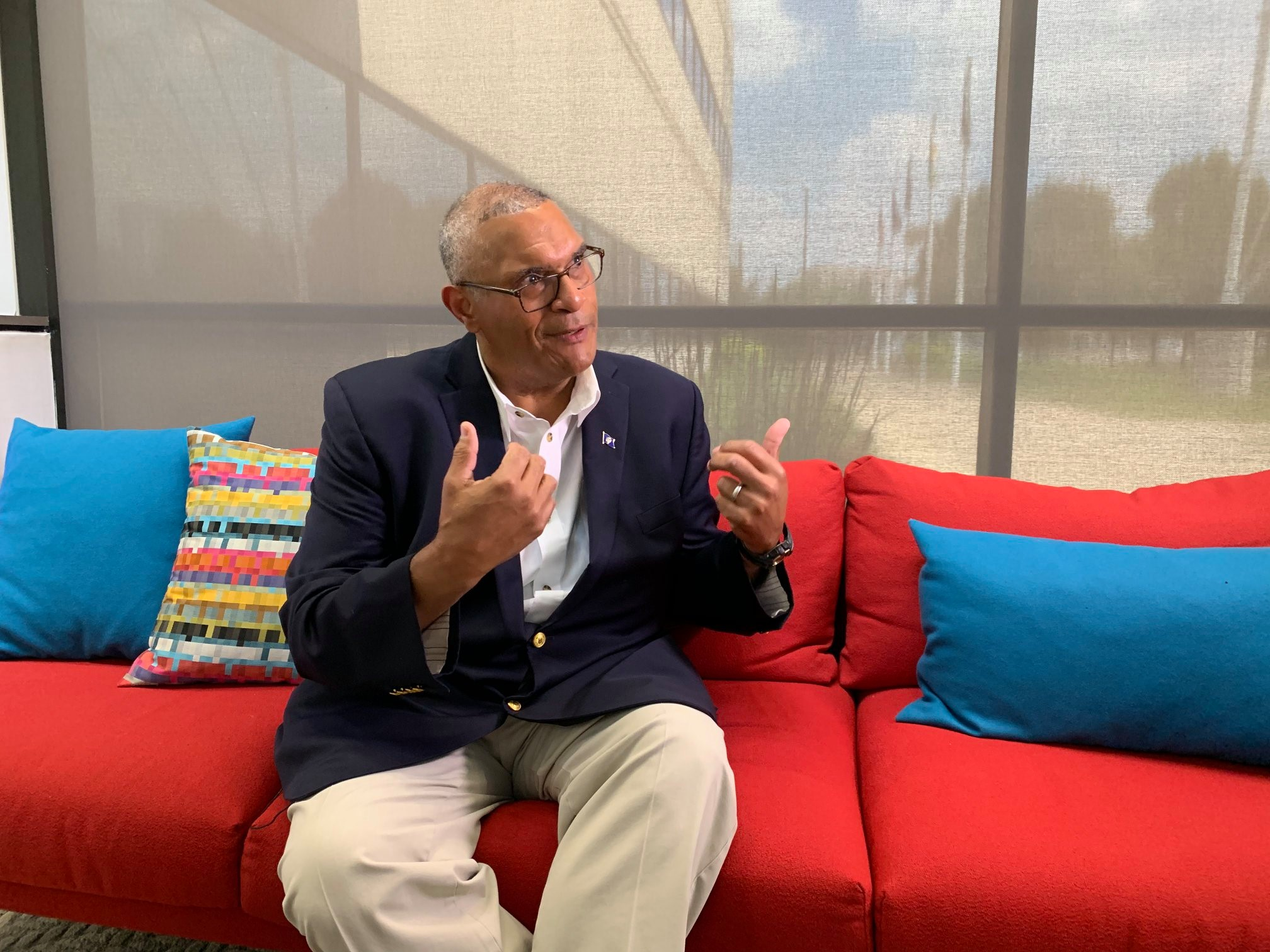 Indiana Democratic gubernatorial candidate Woody Myers sits on a couch