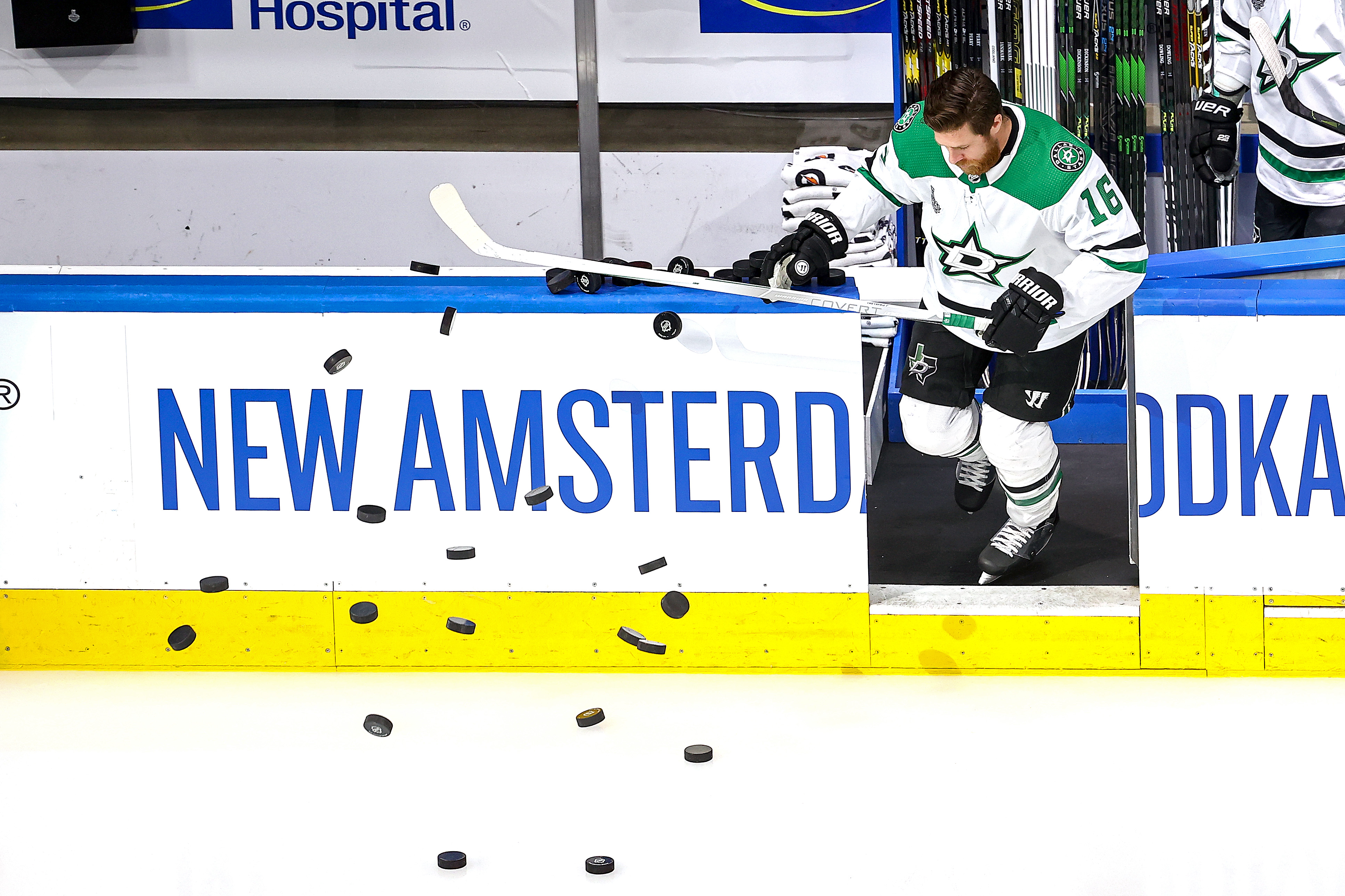 EDMONTON, ALBERTA - SEPTEMBER 26: Joe Pavelski #16 of the Dallas Stars knocks the pucks off of the boards for warm-ups prior to Game Five of the 2020 NHL Stanley Cup Final against the Tampa Bay Lightning at Rogers Place on September 26, 2020 in Edmonton, Alberta, Canada.