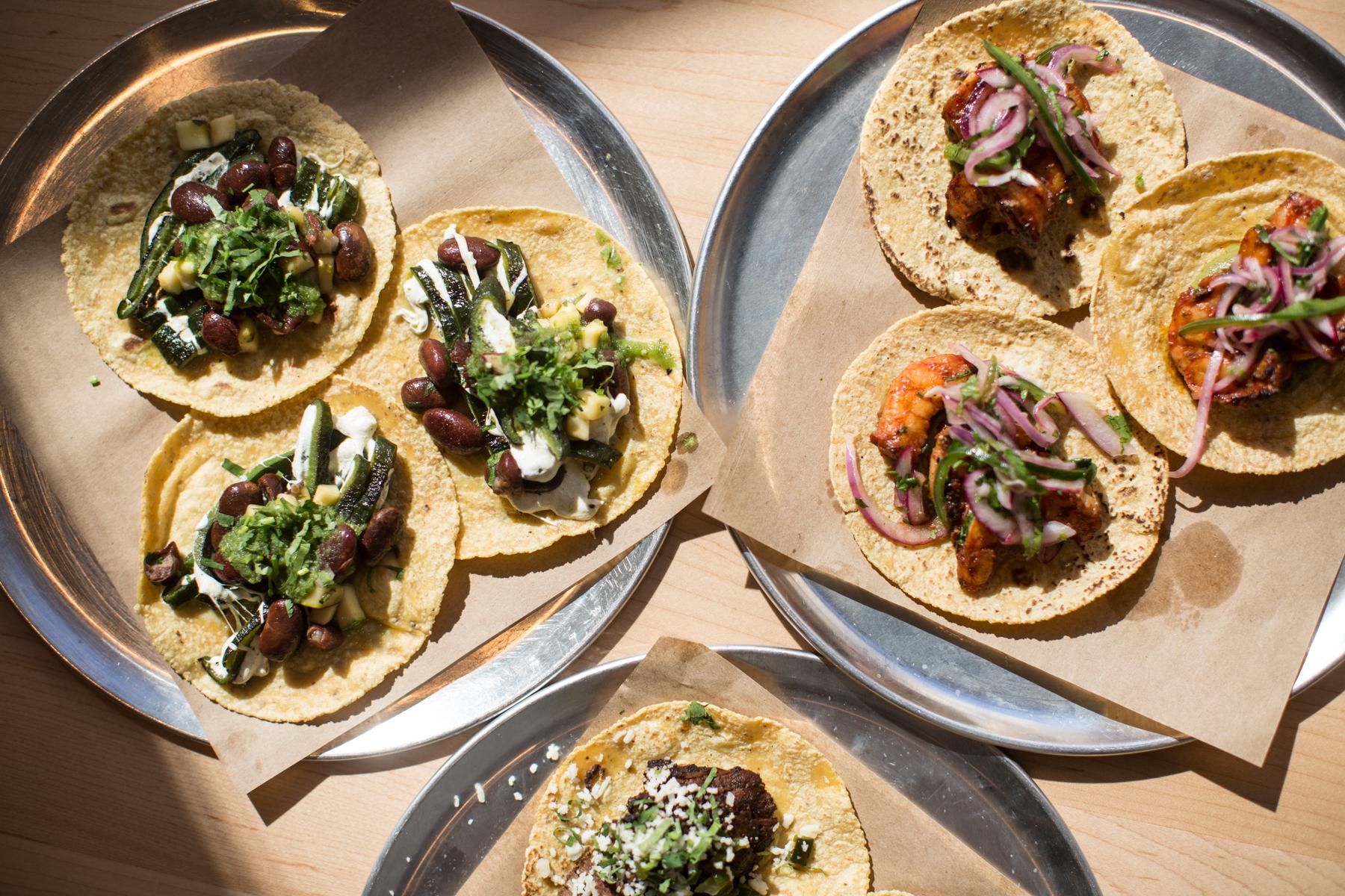 three round trays with tacos