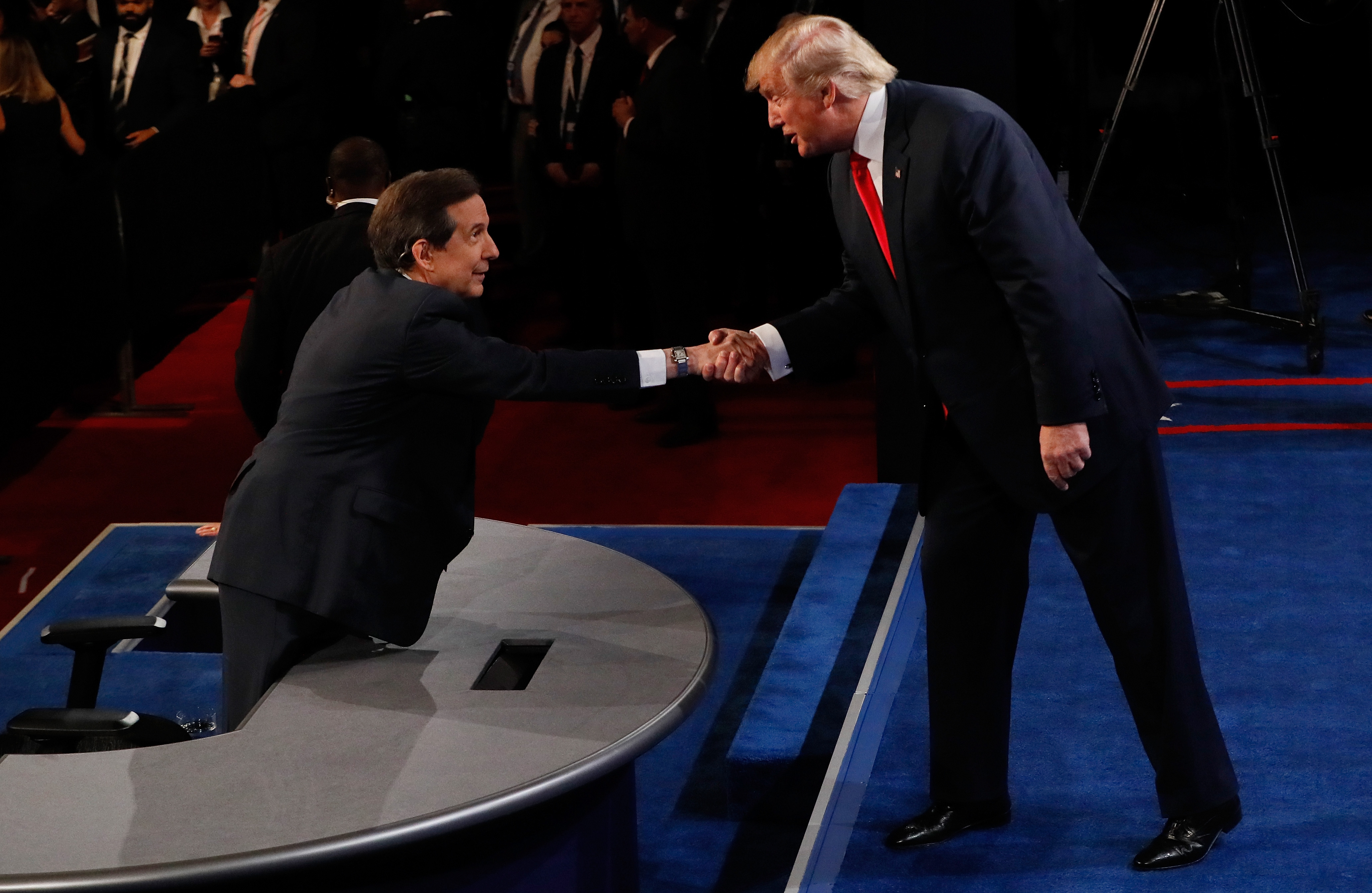 Republican presidential nominee Donald Trump shakes hands with Fox News anchor and moderator Chris Wallace after the third U.S. presidential debate at the Thomas & Mack Center on October 19, 2016 in Las Vegas, Nevada.
