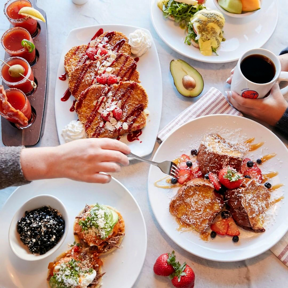 A table full of sweet and savory dishes on the menu at the Broken Yolk Cafe.