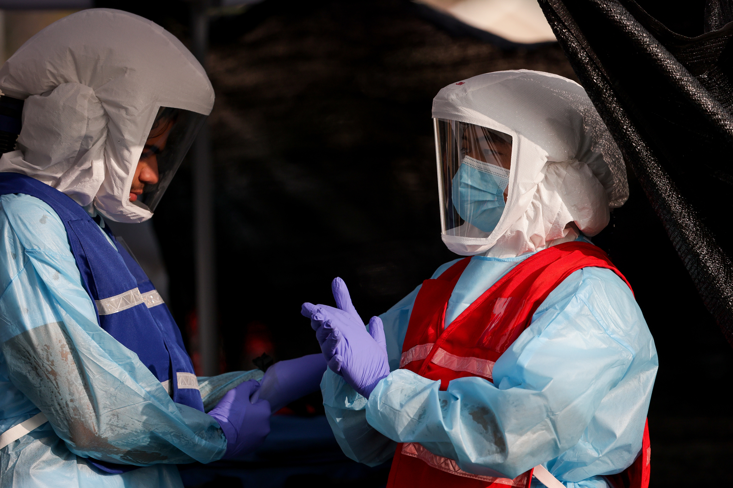 Alborz Alimadadi and Yihao Qin work at a COVID-19 test site run by the Salt Lake County Health Department at Glendale Middle School in Salt Lake City on Tuesday, Sept. 15, 2020.