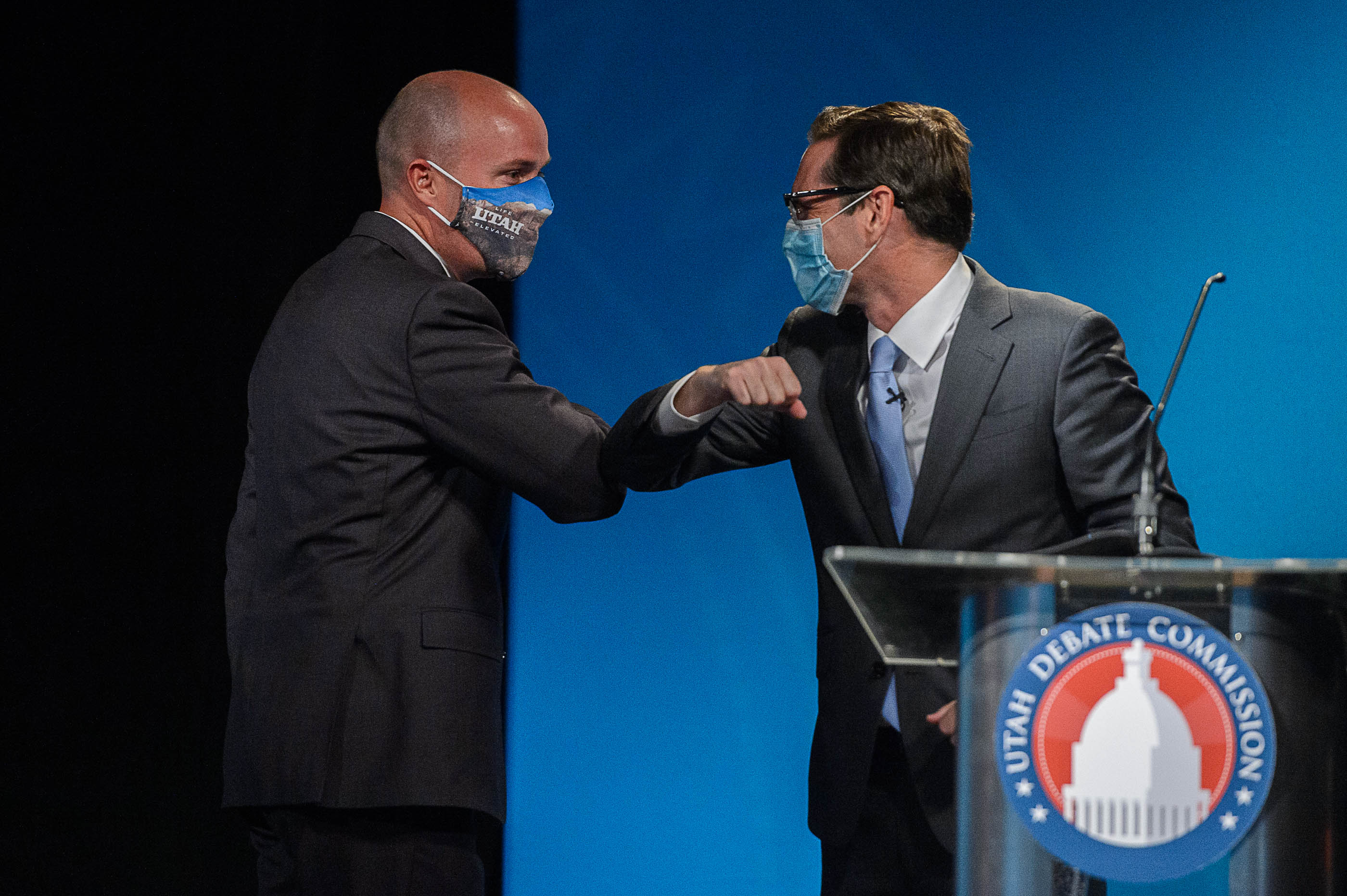 Lt. Gov. Spencer Cox and Chris Peterson, rivals to become Utah's next governor, bump elbows after facing each other in a prime-time debate in Salt Lake City on Tuesday, Sept. 29, 2020.