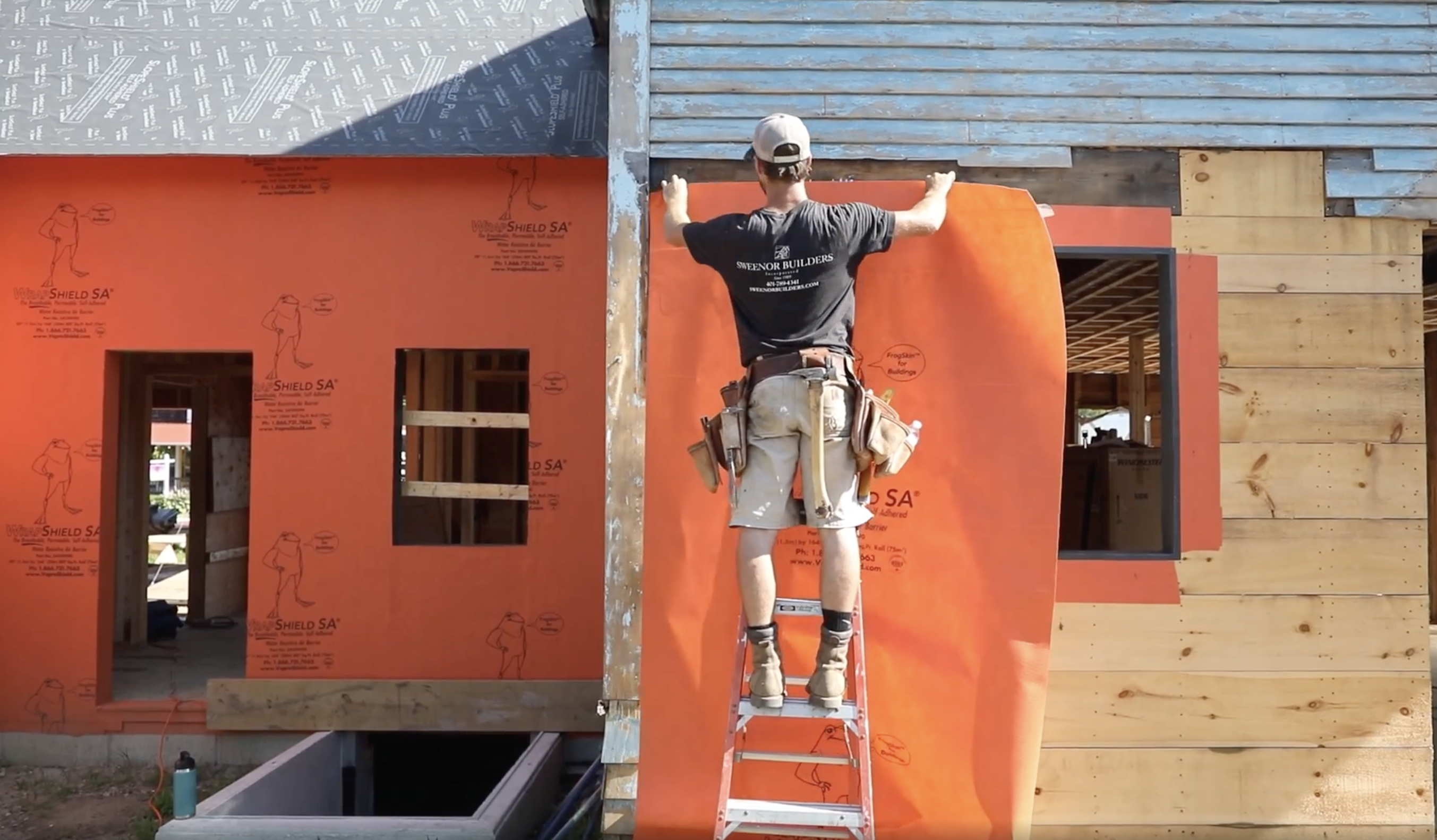 Installing water-resistant air barrier system during siding installation.