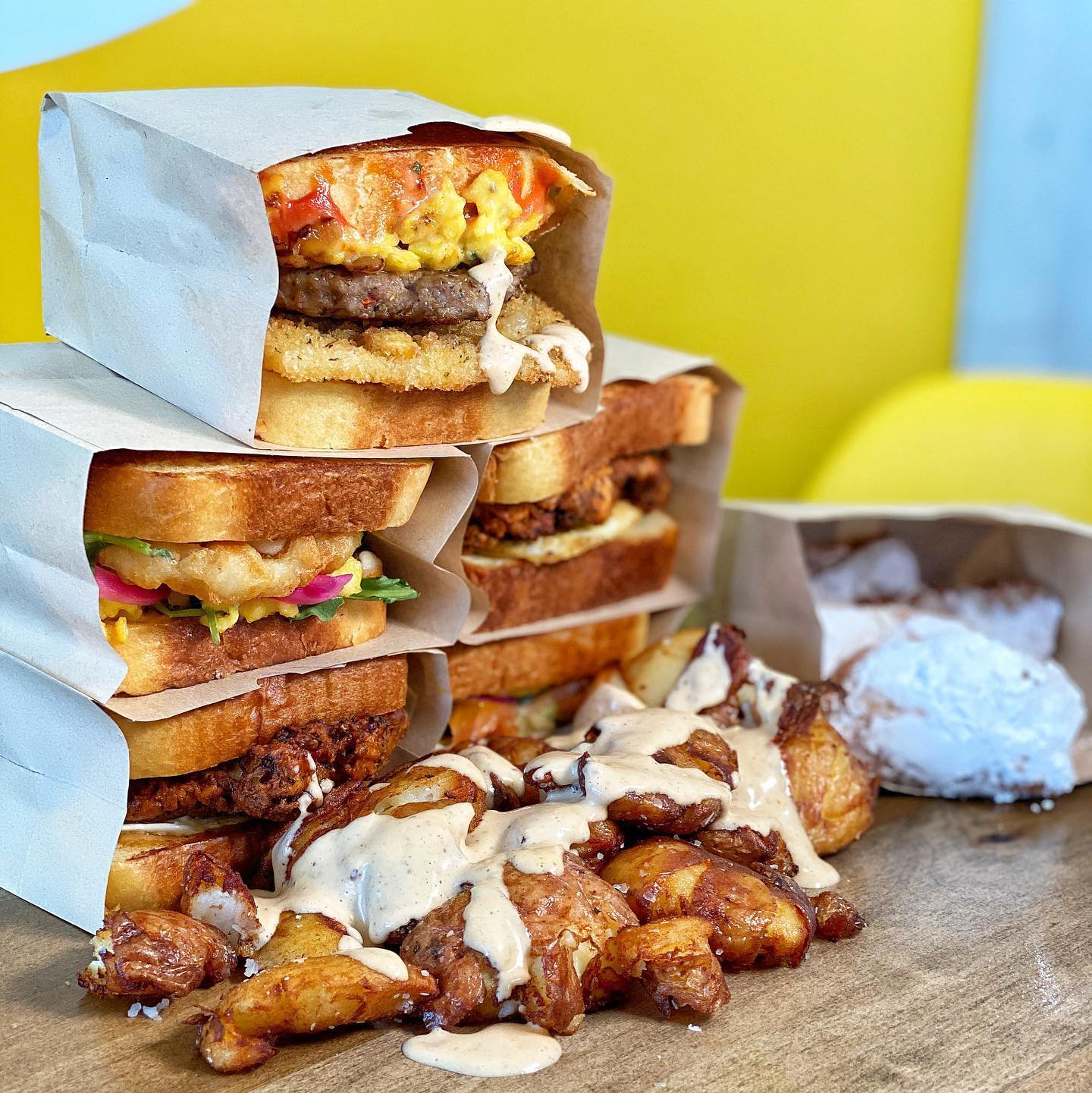 Five breakfast sandwiches stacked