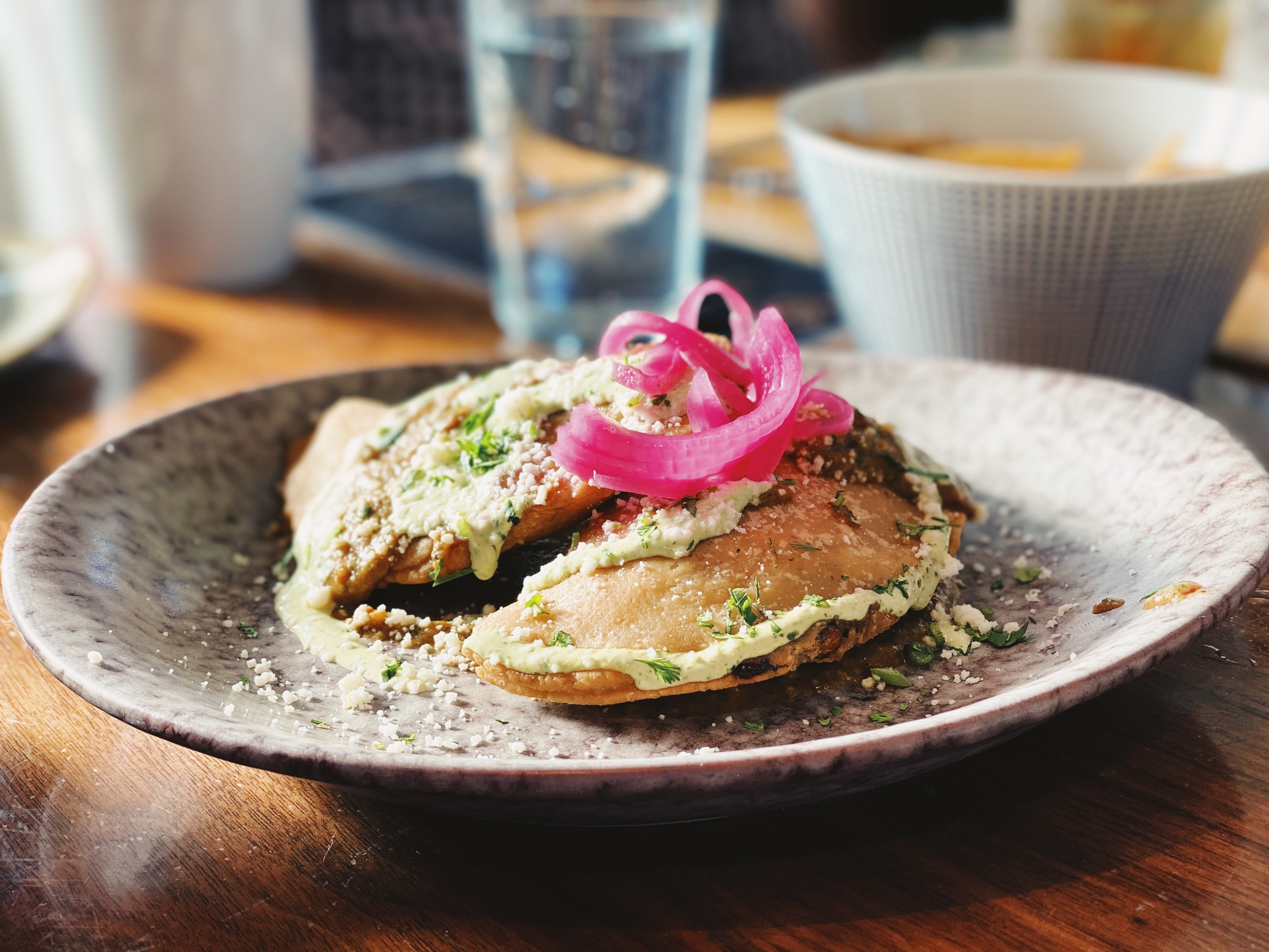 An earthenware plate with empanadas