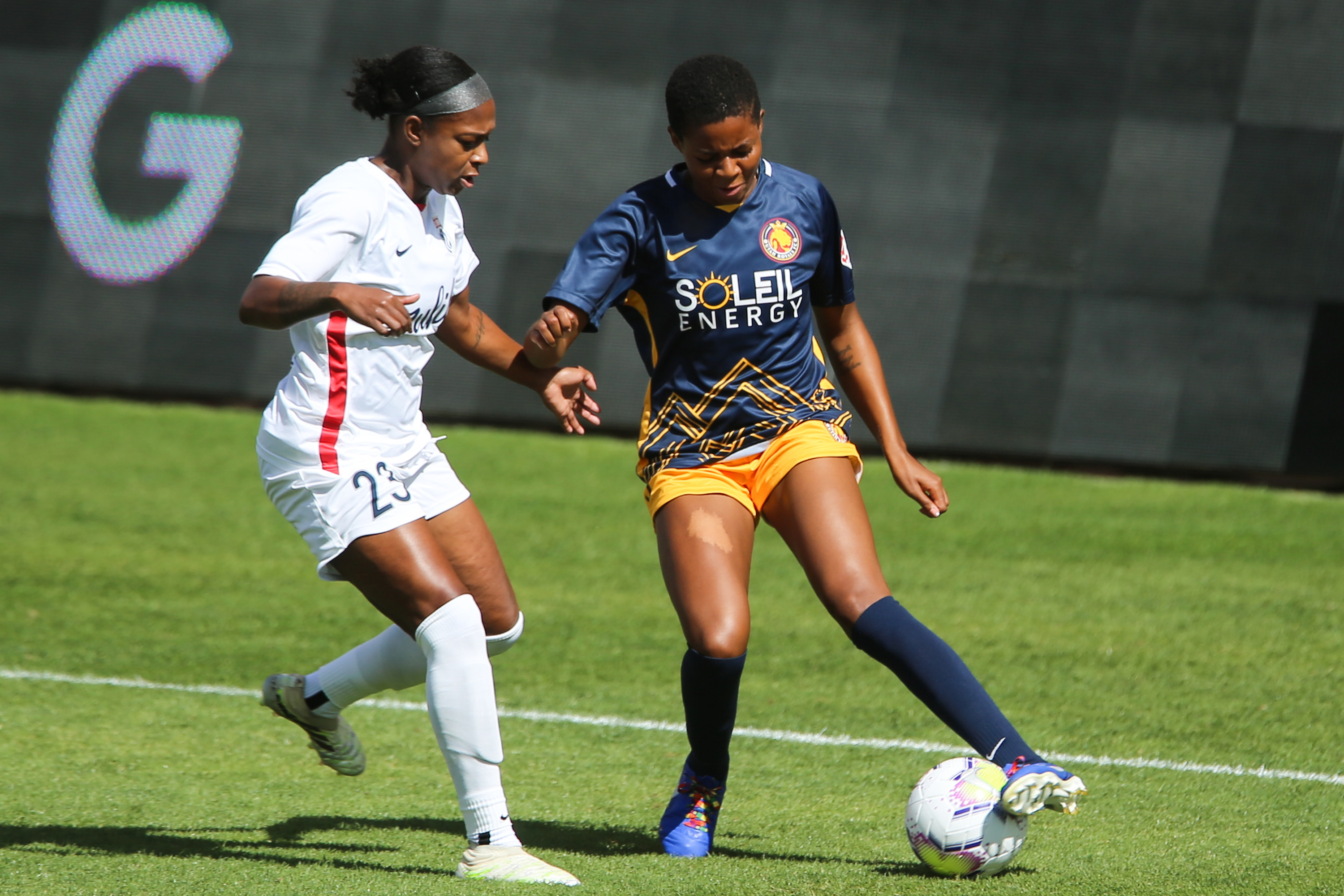 Utah Royals FC defender Tziarra King (3) controls the ball against OL Reign FC defender Taylor Smith (23) during a NWSL soccer game at Rio Tinto Stadium in Sandy on Saturday, Sept. 26, 2020.