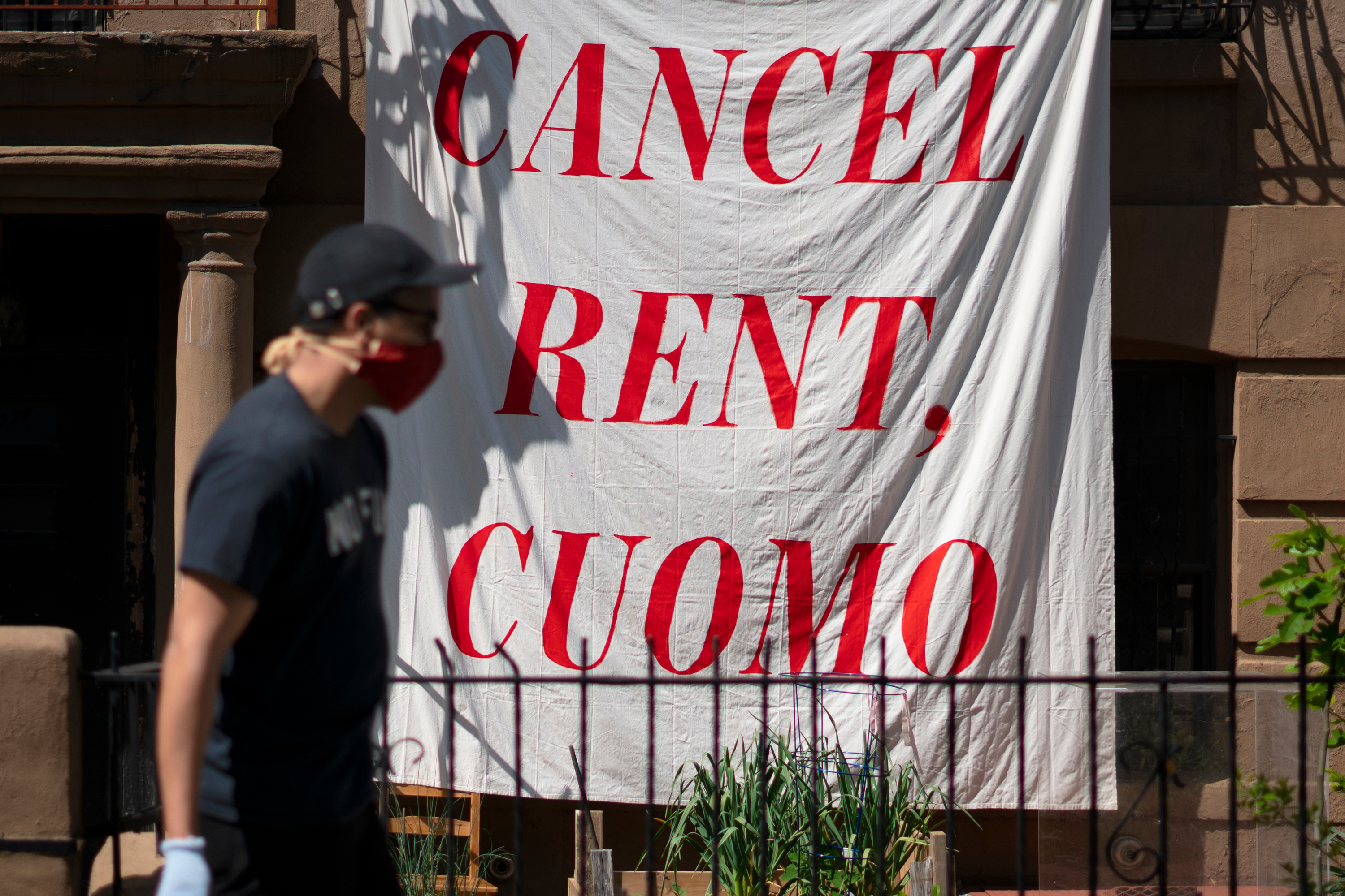 A bedsheet hung in Crown Heights, Brooklyn speaks to tough economic times during the coronavirus outbreak, May 29, 2020.