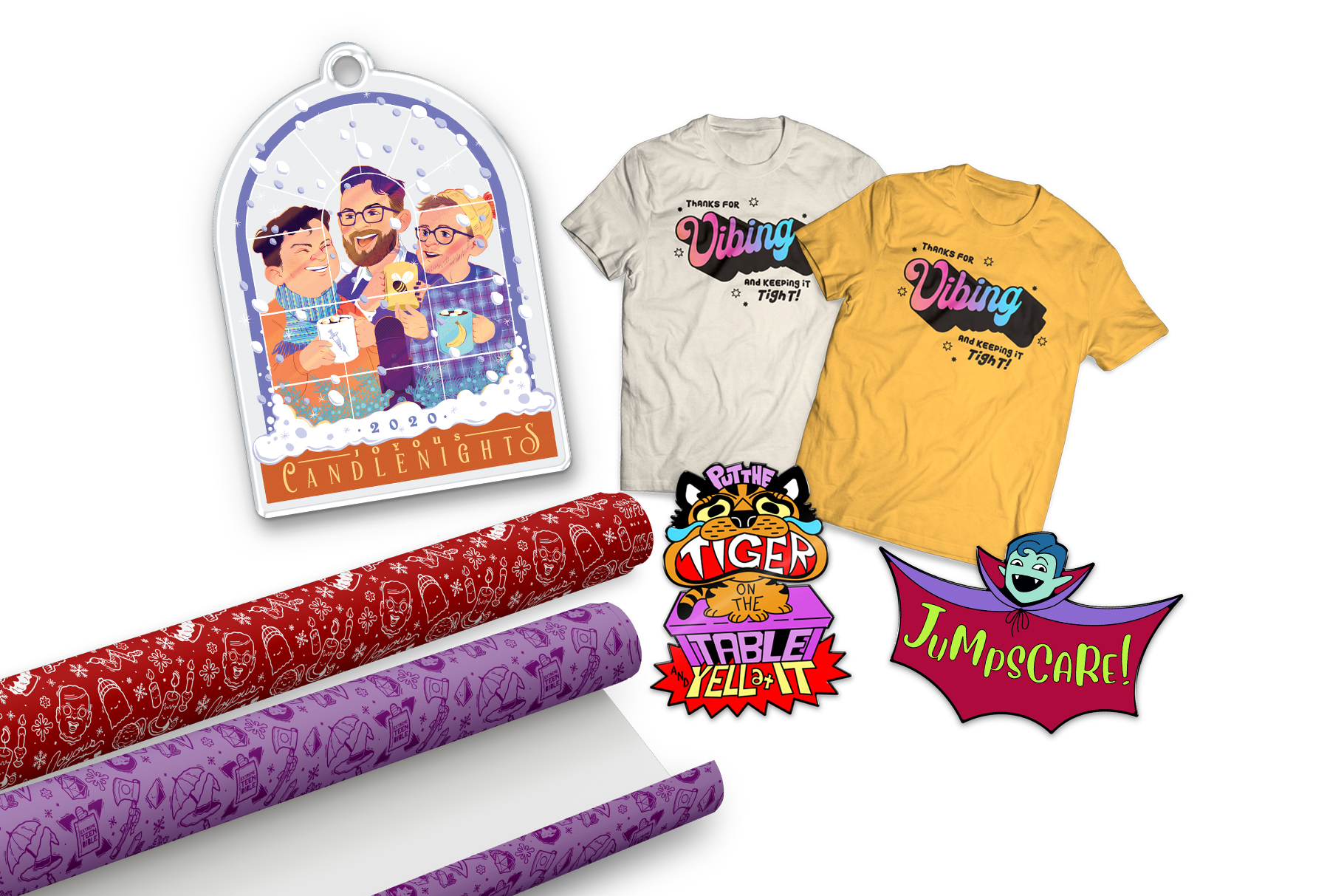 """Image of the five October McElroy merch items: an acrylic Candlenights ornament, two shirts that say, """"Thanks for vibing and keeping it tight!"""", an enamel pin of a crying cartoon tiger, an enamel pin of Justin as a vampire that says """"Jumpscare!"""", a roll of red MBMBaM wrapping paper, and a roll of purple TAZ wrapping paper."""