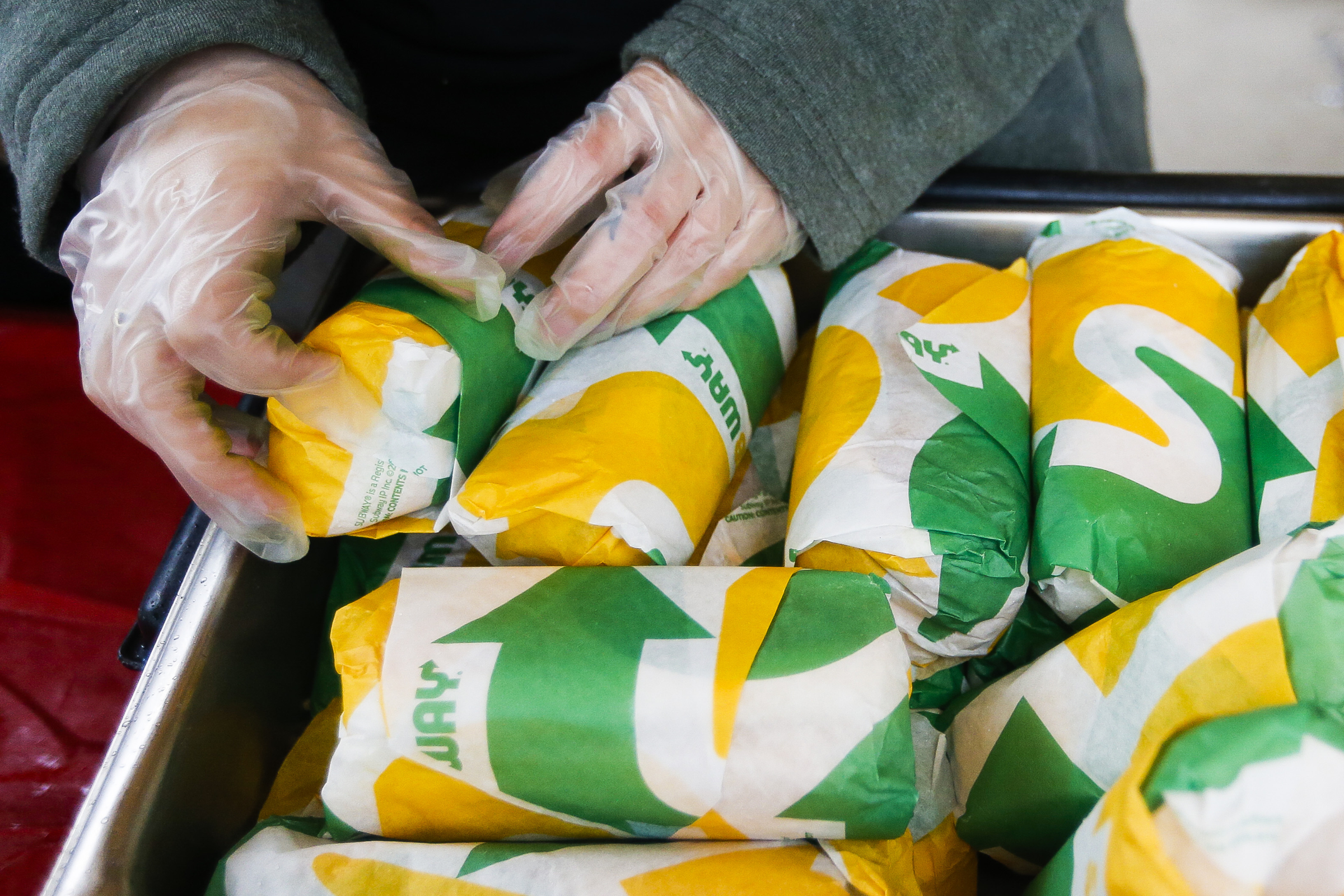 A Subway employee hands out free sandwiches during the 8th annual Subway Day at Pioneer Park in Salt Lake City on Tuesday, May 16, 2017. Subway Restaurants in Utah teamed with the Rescue Mission to provide the sandwiches and other services for homeless individuals.