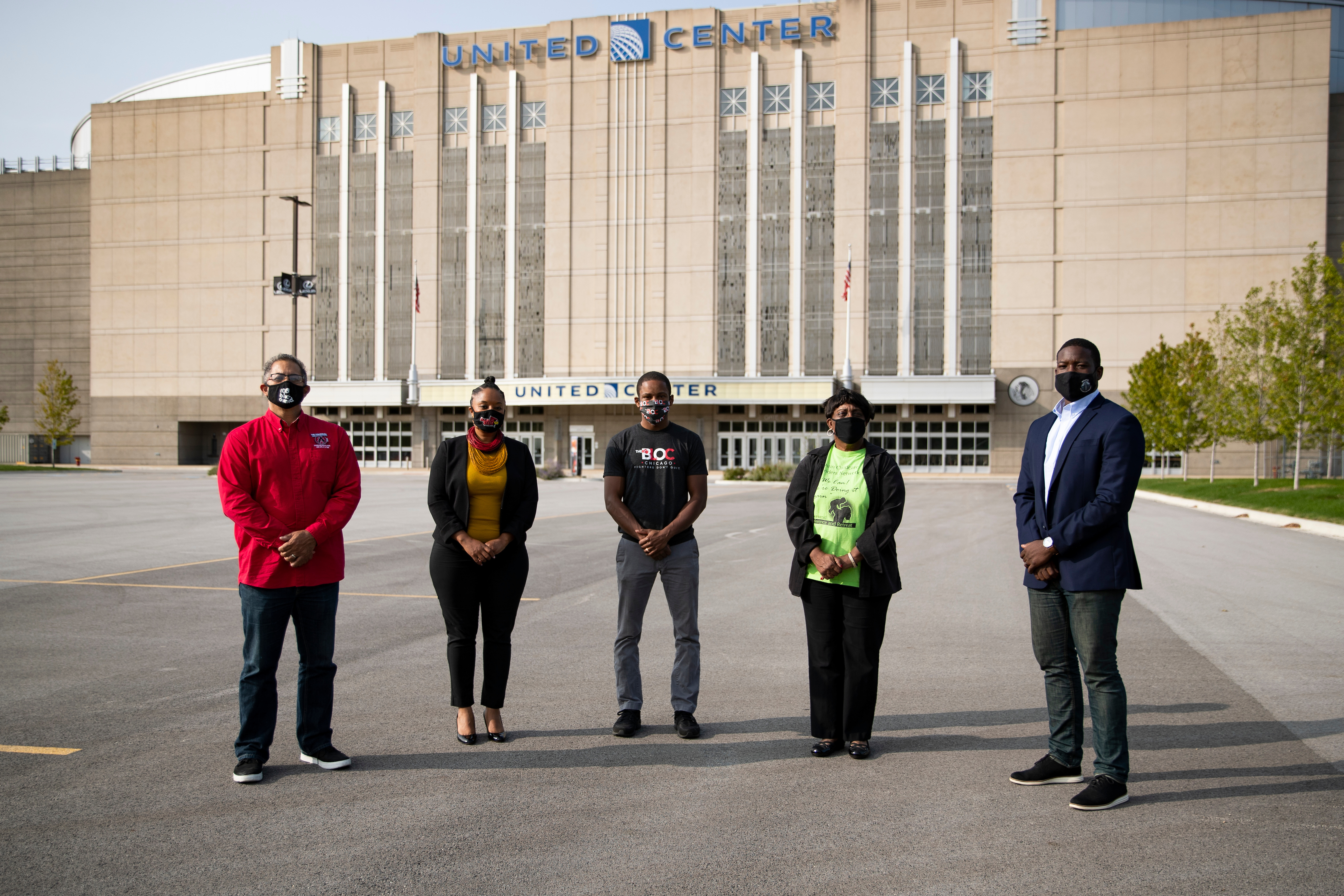 The five inaugural recipients of One West Side grants — Phil Jackson (from left), Ayesha Jaco, Jamyle Cannon, Ruth Kimble and Marshall Hatch — outside the United Center.