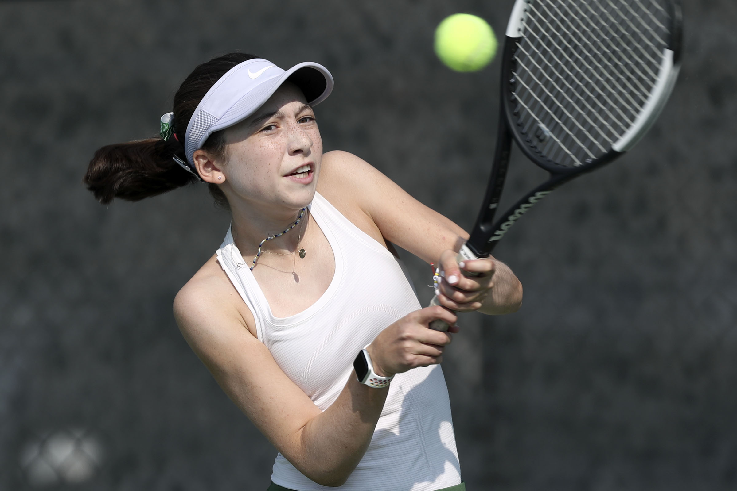 Rowland Hall's Lucy Wallin competes in the first singles finals of the 3A girls tennis state championship against Waterford's Sophie Christensen at Liberty Park in Salt Lake City on Saturday, Oct. 3, 2020. Wallin won.
