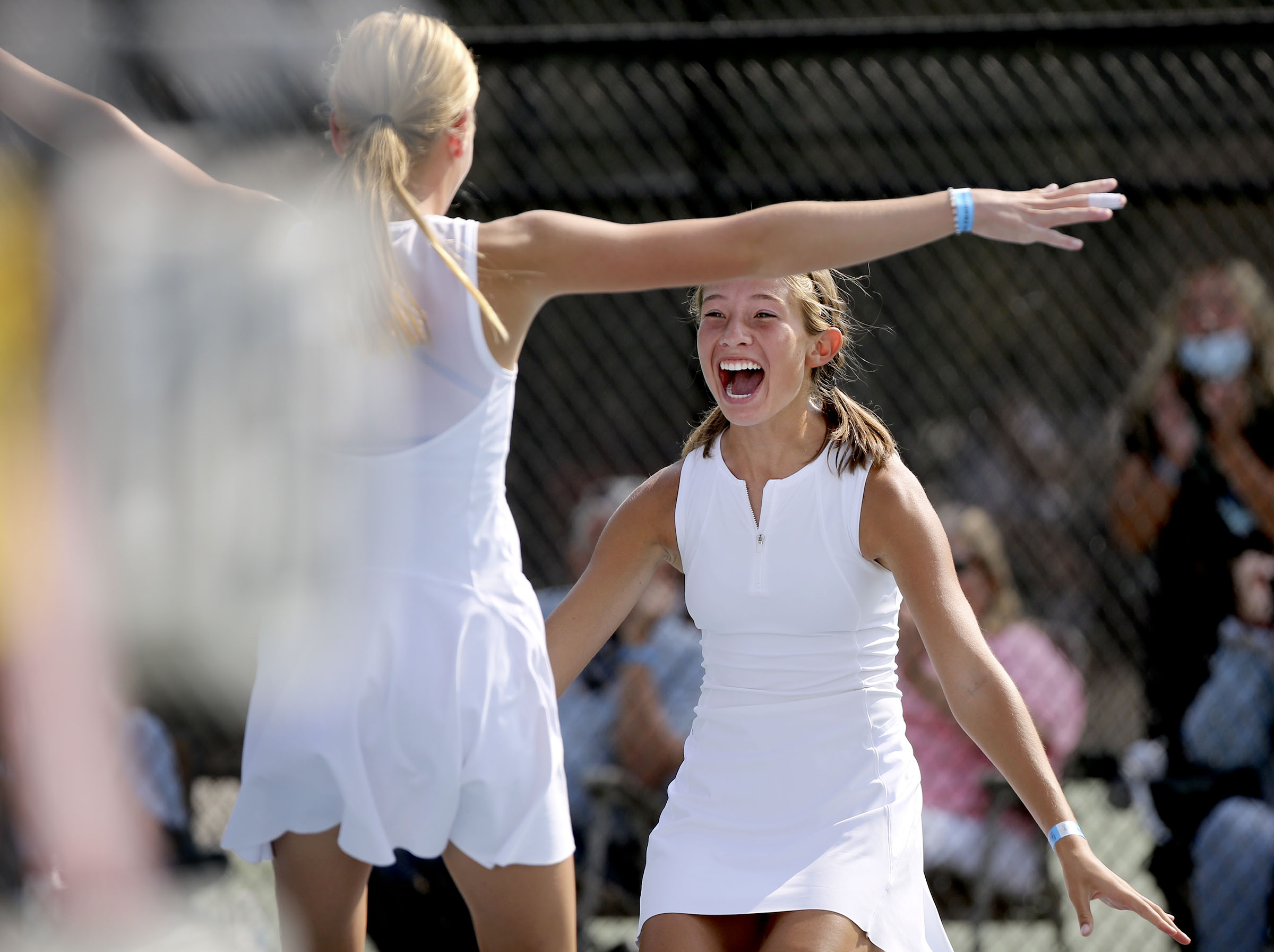Timpview's Emma Wilkinson, right, and Kylie Woods react to winning the first doubles finals against Alta during the 5A girls tennis state championship at Liberty Park in Salt Lake City on Saturday, Oct. 3, 2020.