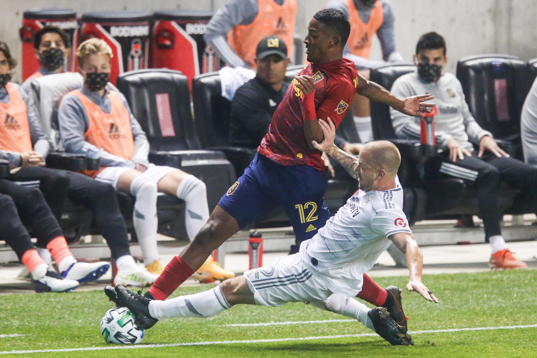 Los Angeles FC defender Jordan Harvey (2) slide tackles Real Salt Lake forward Douglas Martinez (12) during a MLS soccer game at Rio Tinto Stadium in Sandy on Sunday, Oct. 4, 2020.