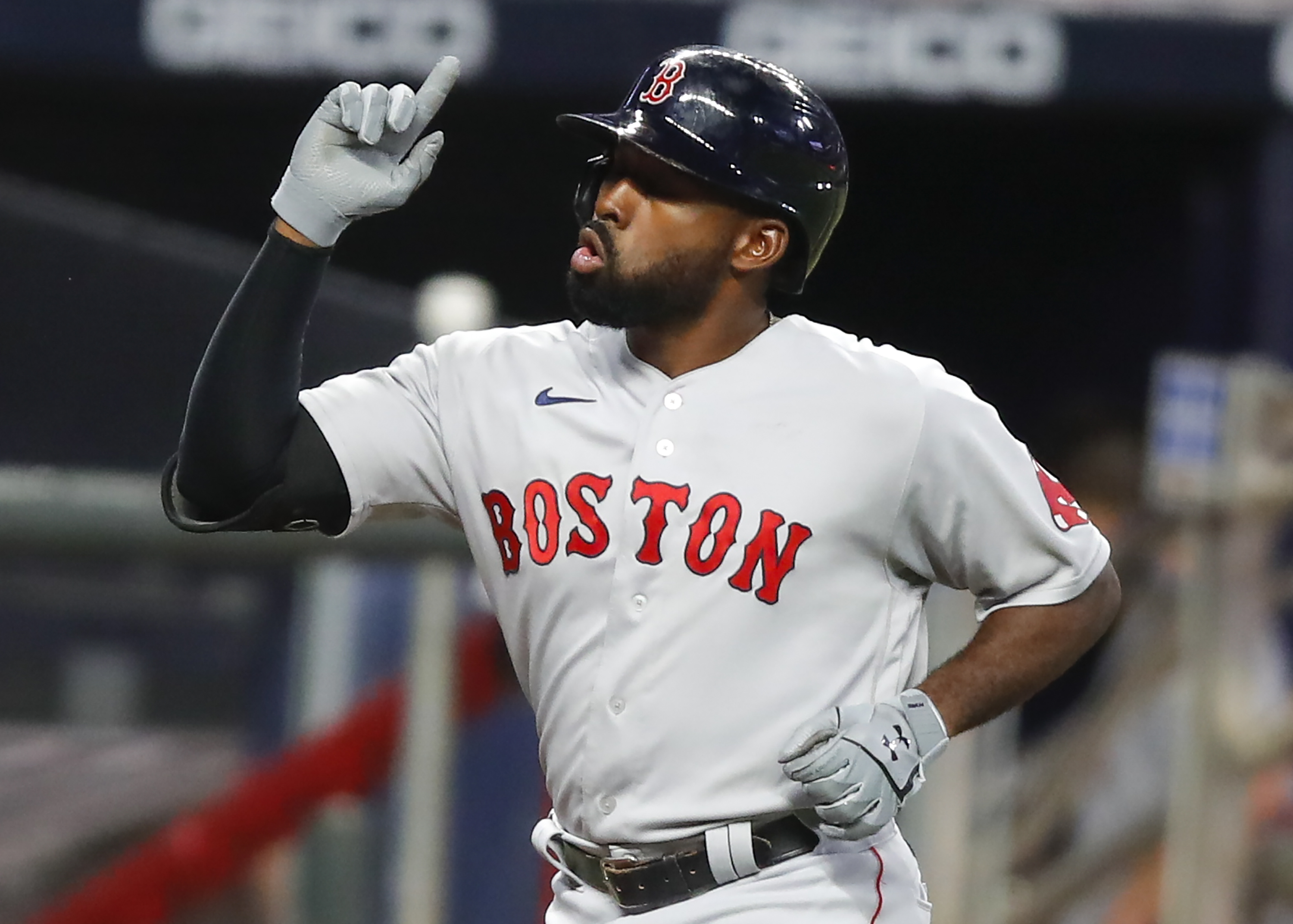 Jackie Bradley Jr. #19 of the Boston Red Sox reacts after hitting a solo home run in the fifth inning of an MLB game against the Atlanta Braves at Truist Park on September 25, 2020 in Atlanta, Georgia.