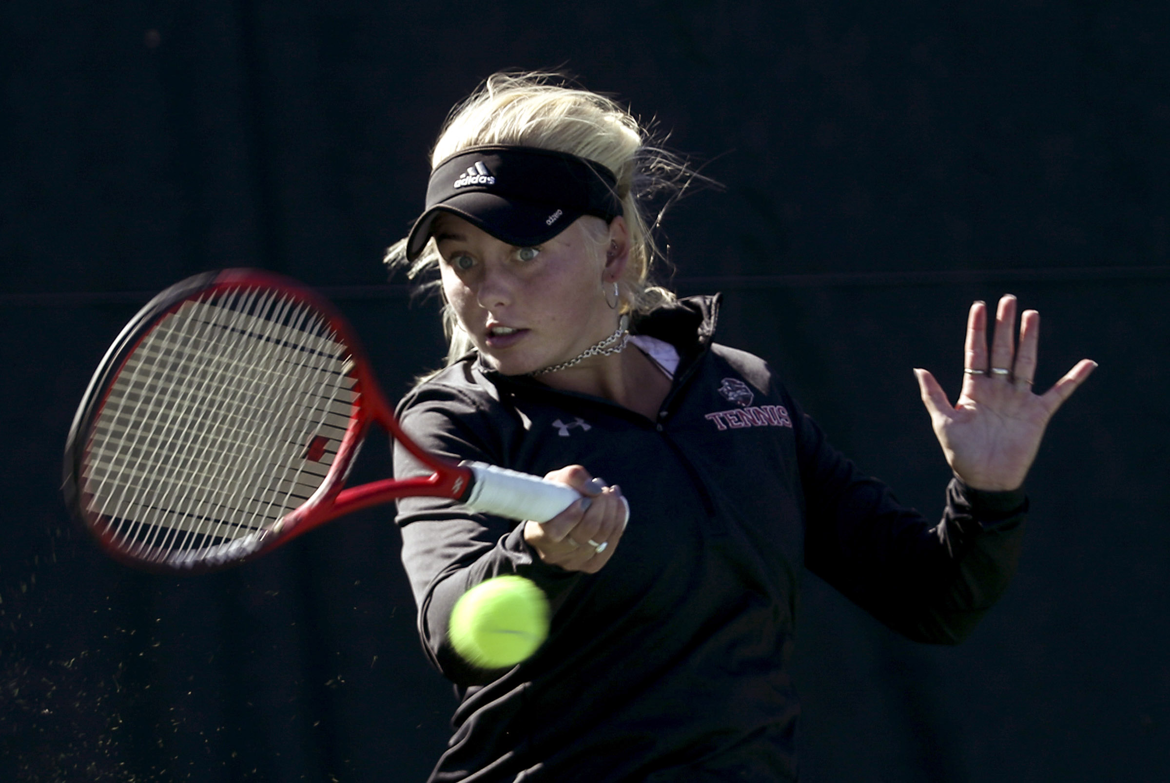 Weber's Jacque Dunyon rips a forehand on her way to the first singles championship with a victory over Davis' Sarah Major during the 6A State tournament at Liberty Park in Salt Lake City on Saturday, Oct. 5, 2019.