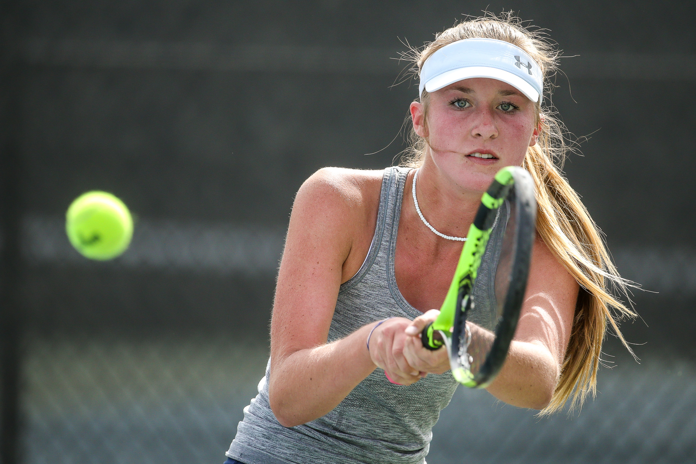 Ridgeline's Madi Brenchley competes in the No. 3 singles championship match against Park City's Brooklyn Thompson during the 4A state tennis tournament at the Liberty Park Tennis Center in Salt Lake City on Saturday, Sept. 29, 2018.
