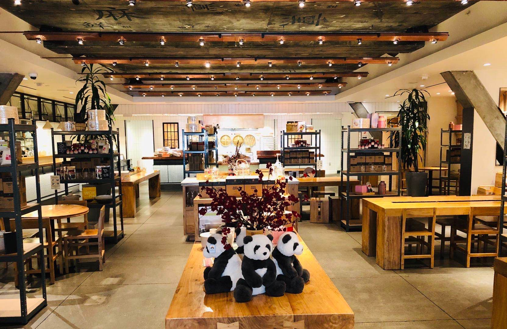 The dining room at China Live, now laid out as a hybrid retail market space, with a display of stuffed pandas in the foreground