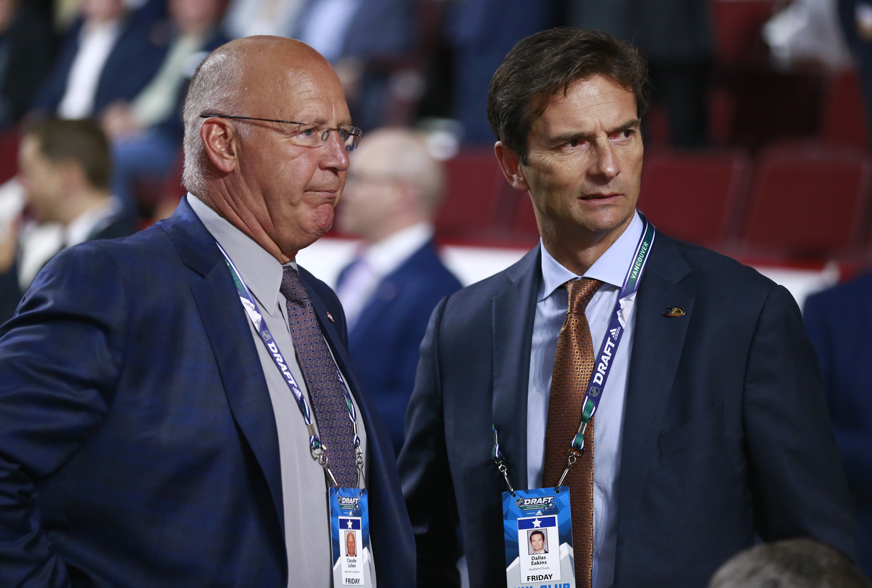 VANCOUVER, BRITISH COLUMBIA - JUNE 21: Head coach Claude Julien of the Montreal Canadiens and head coach Dallas Eakins of the Anaheim Ducks look on from the draft floor during the first round of the 2019 NHL Draft at Rogers Arena on June 21, 2019 in Vancouver, Canada.