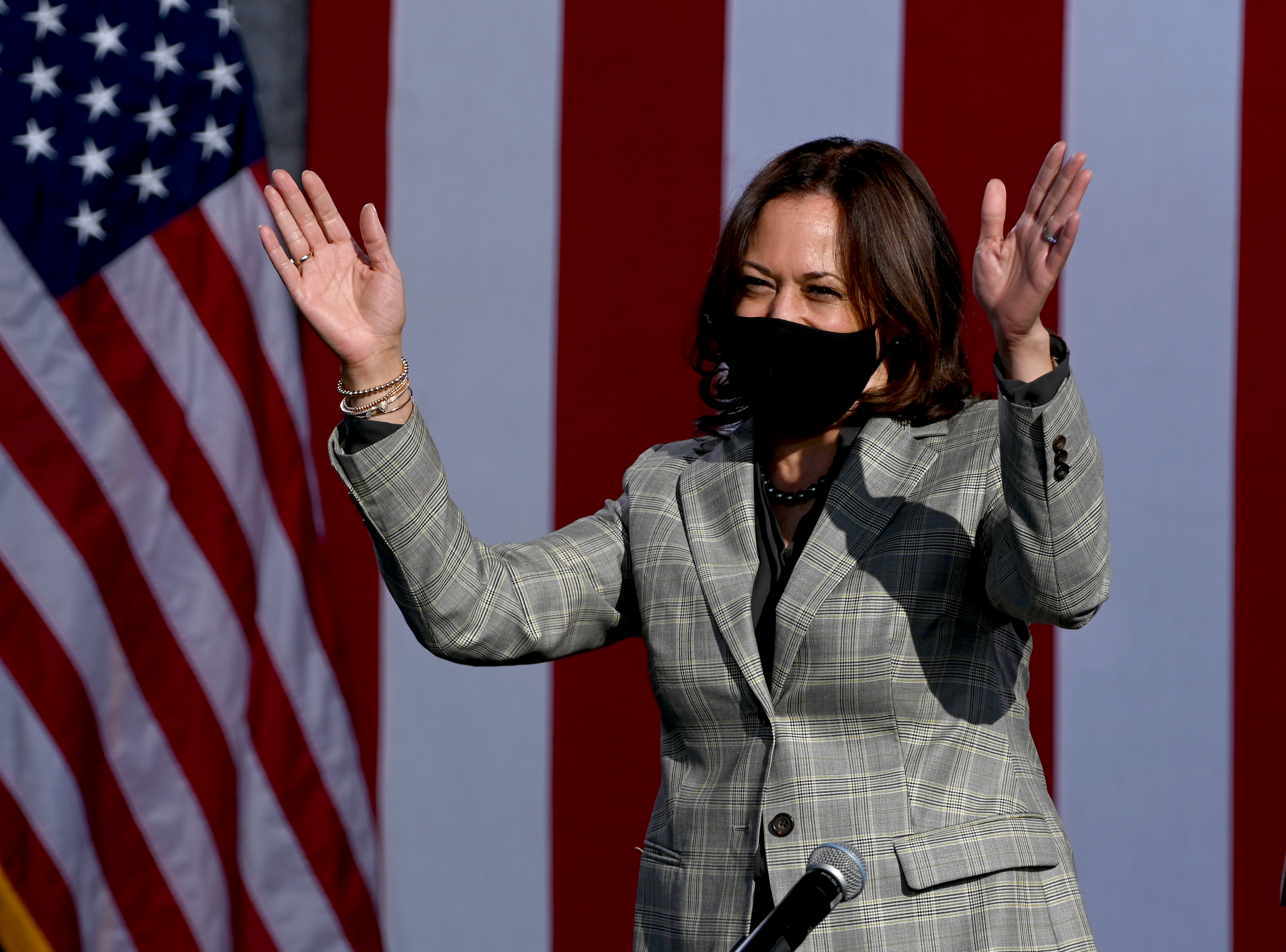 Democratic U.S. Vice Presidential nominee Sen. Kamala Harris waves as she arrives at a voter mobilization drive-in event at UNLV on October 2, 2020 in Las Vegas, Nevada.