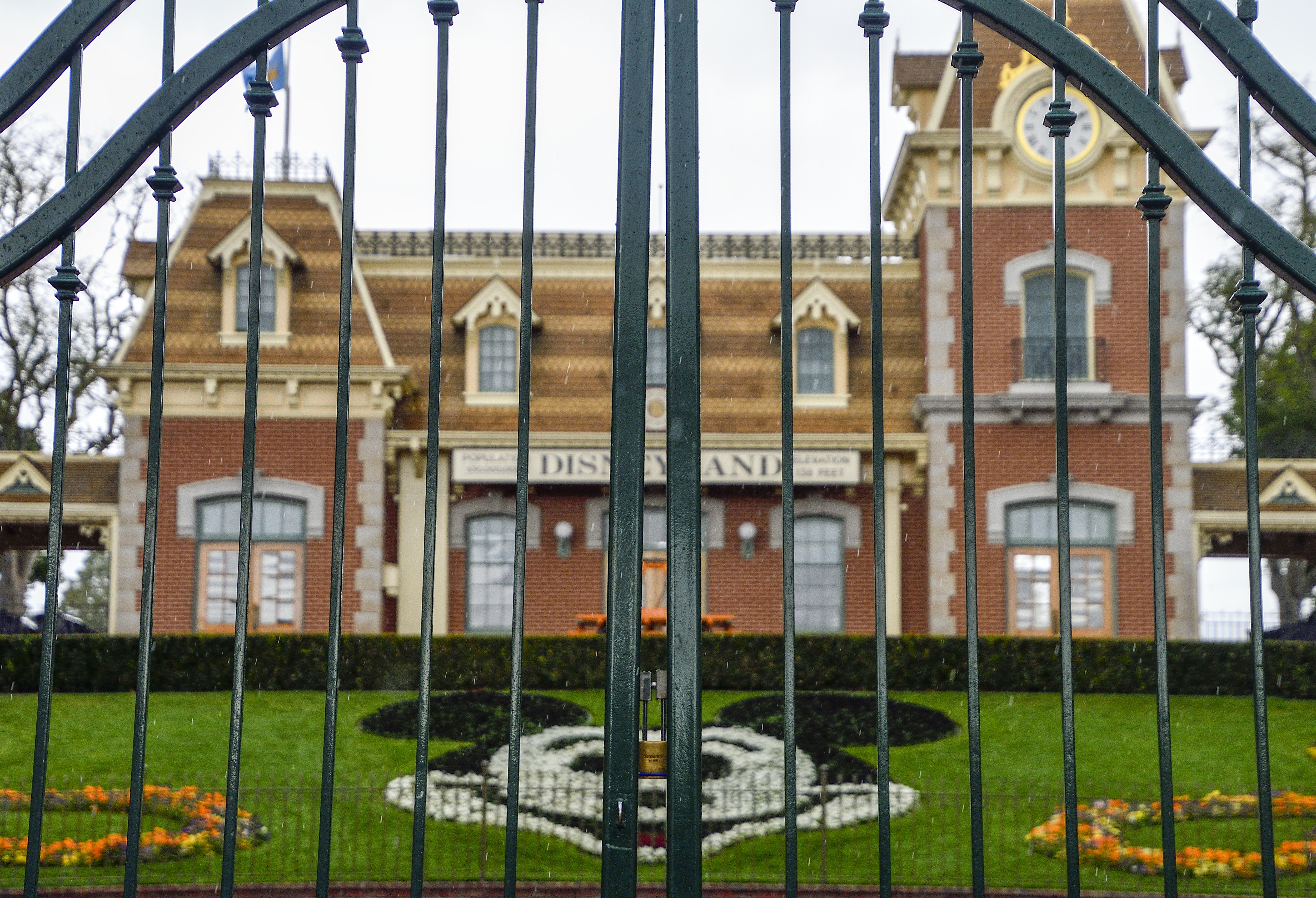 A lock hangs on the center gate between the turnstiles at the entrance to Disneyland in Anaheim, California.