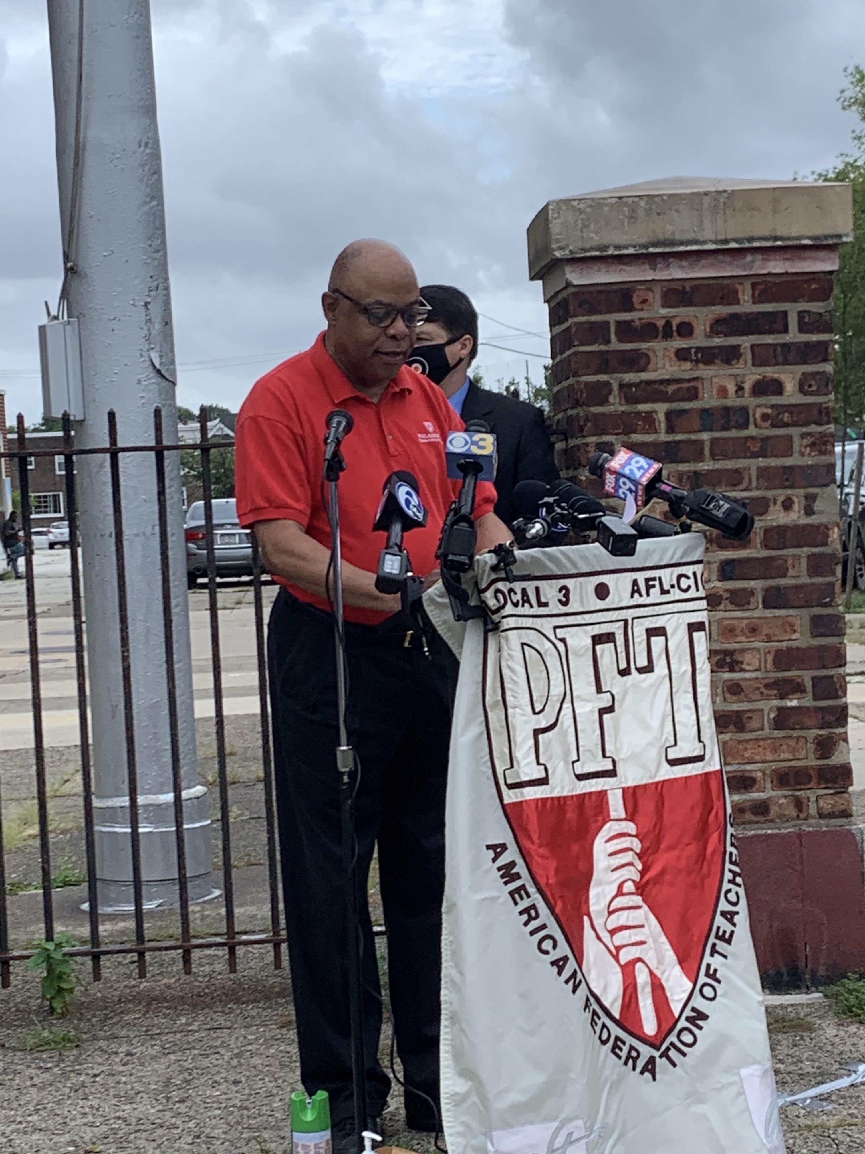 Jerry Jordan speaking at a podium.