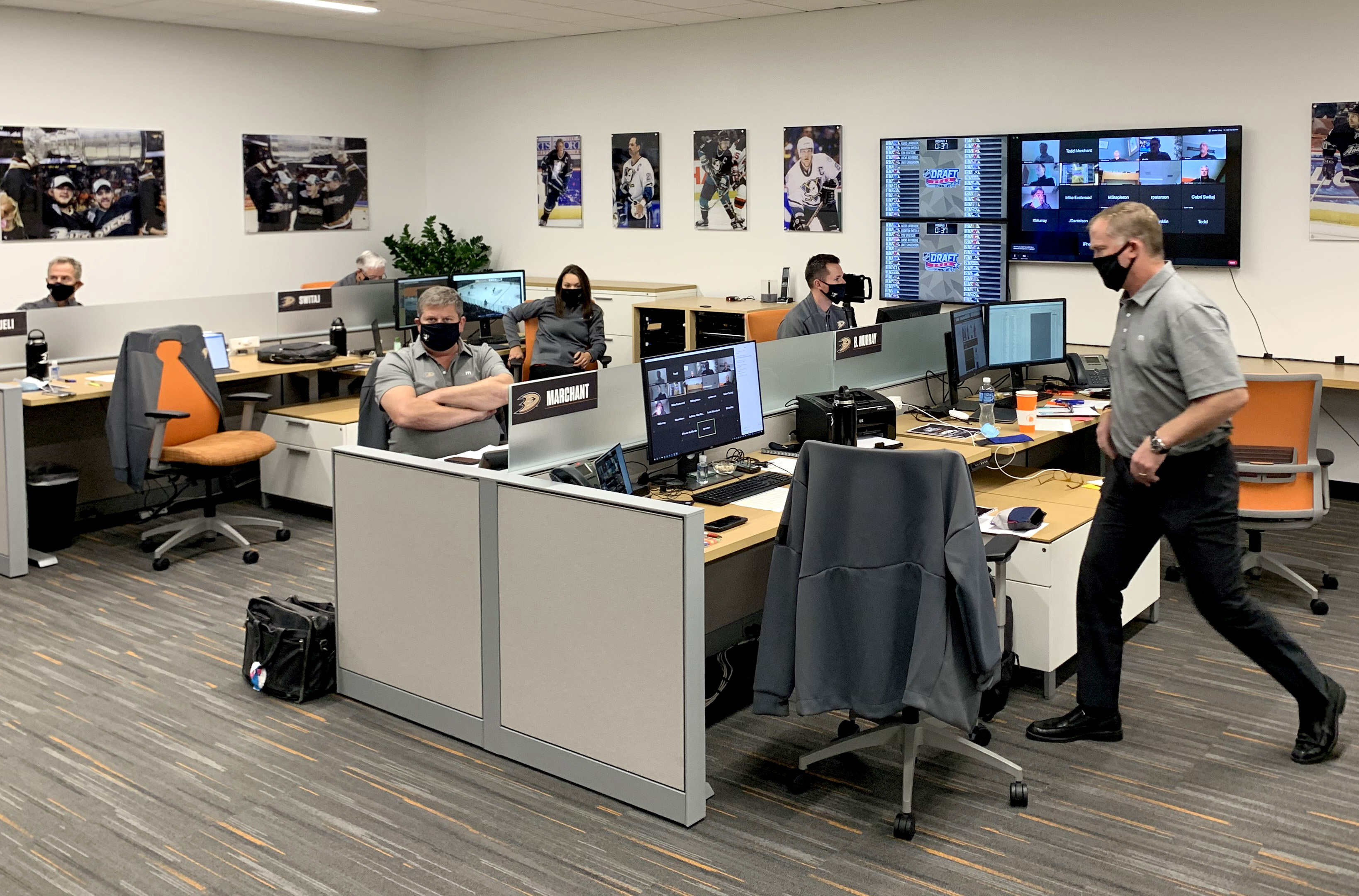 IRVINE, CALIFORNIA- OCTOBER 06: The Anaheim Ducks team personnel works in their draft room during the first round of the 2020 NHL Entry Draft at the Great Park Ice on October 06, 2020 in Irvine, California. The 2020 NHL Draft was held virtually due to the ongoing Coronavirus pandemic.