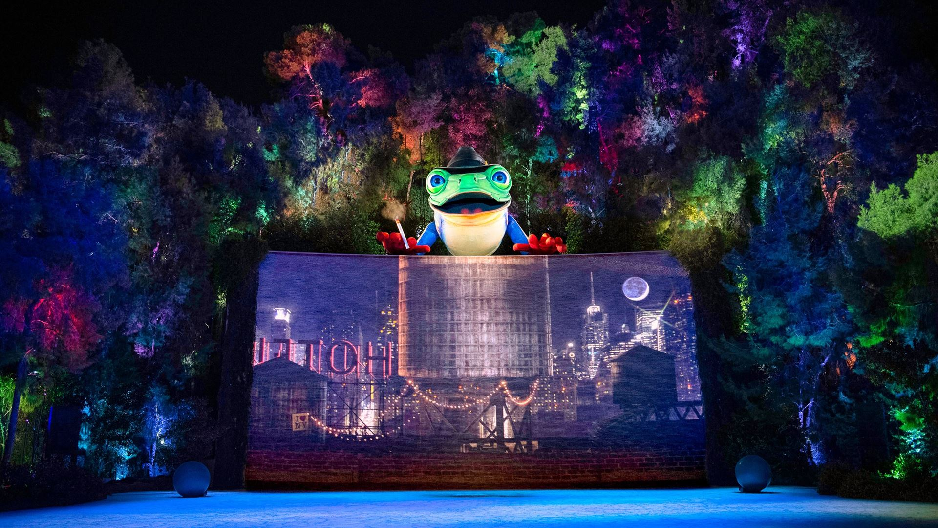 An animitronic frog sits on top of a waterfall