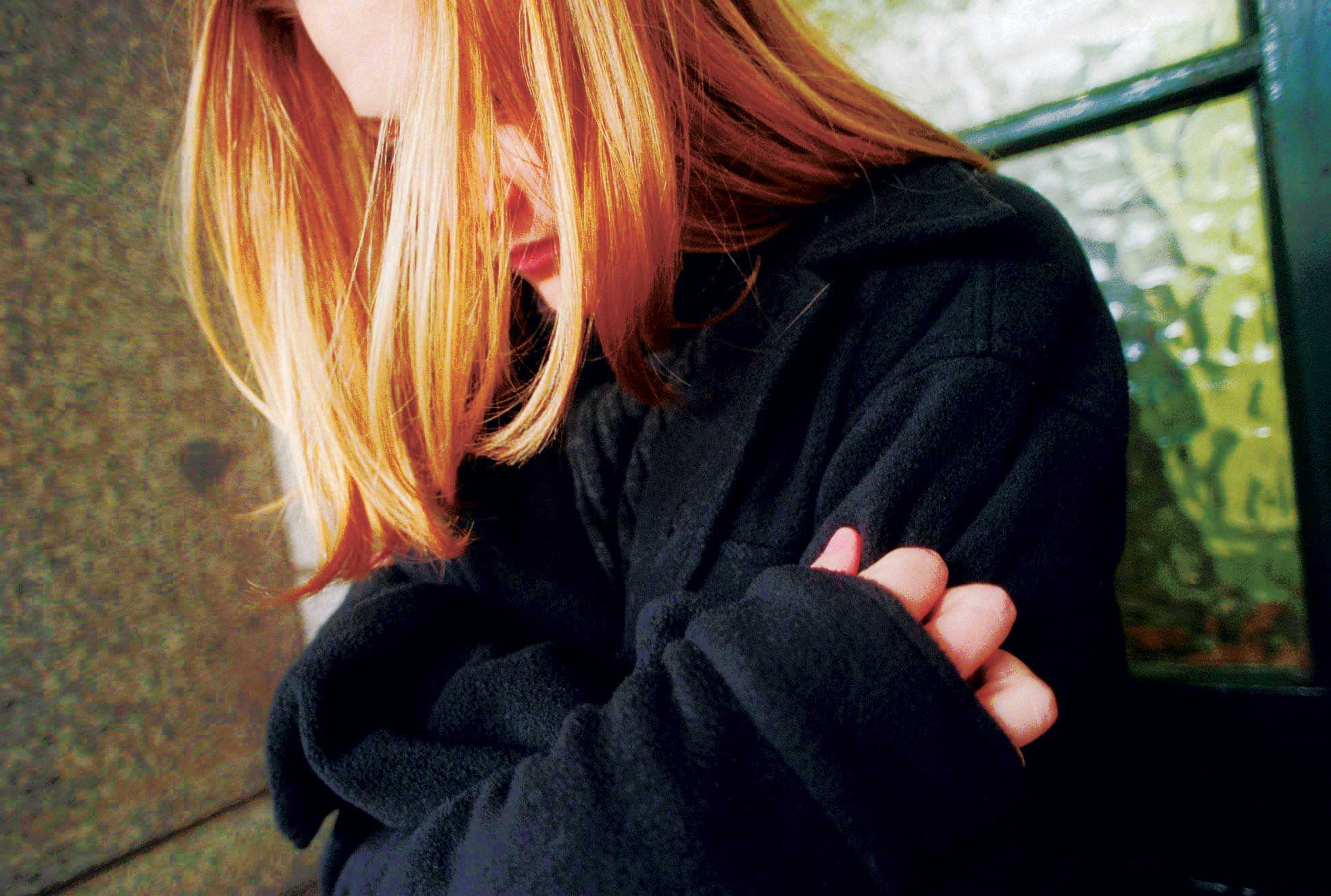A young girl holds herself for sescurity, 24 June 1998. THE AGE Picture by ANGE