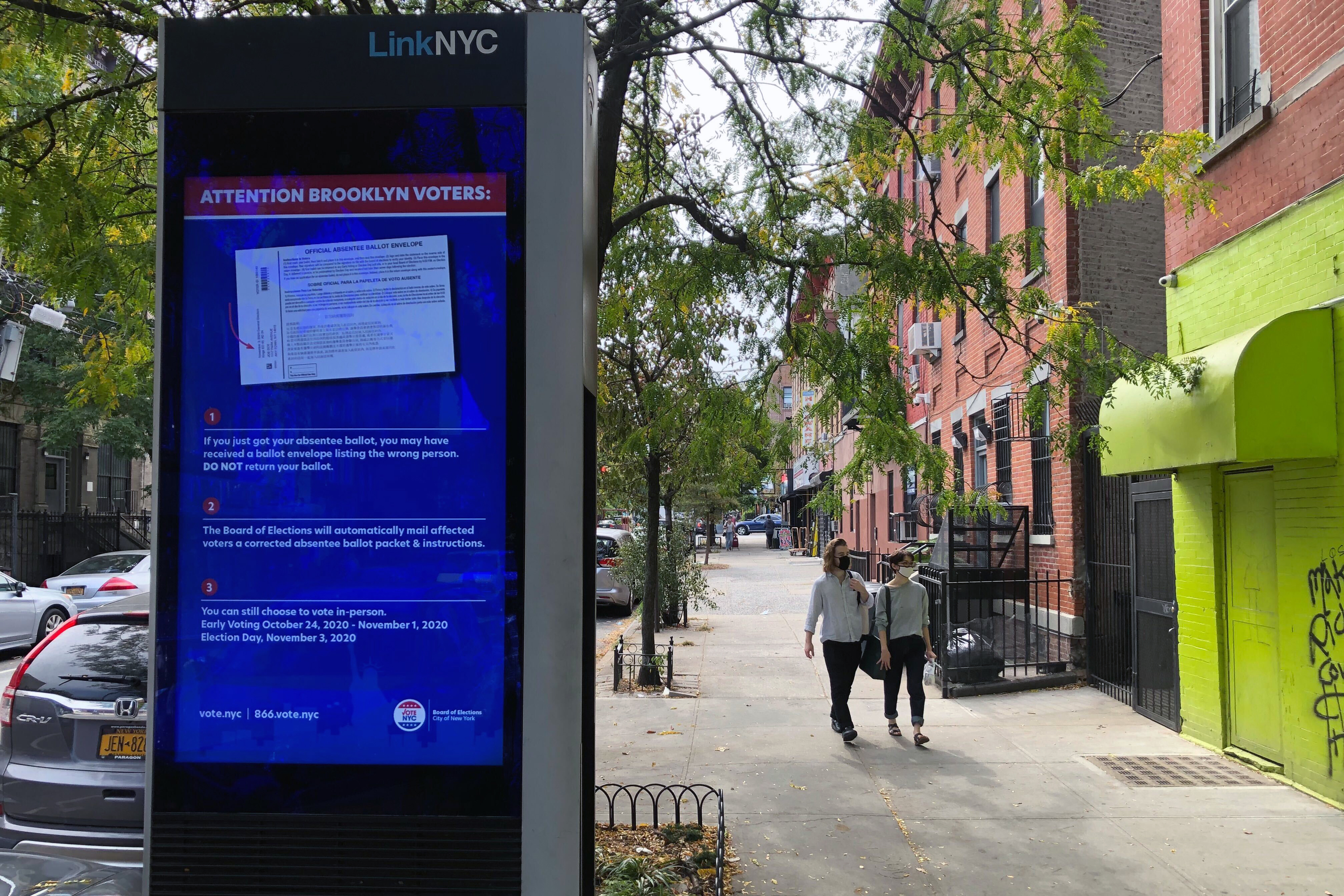 An ad on a LinkNYC kiosk in Crown Heights warns Brooklyn voters about faulty absentee ballots.