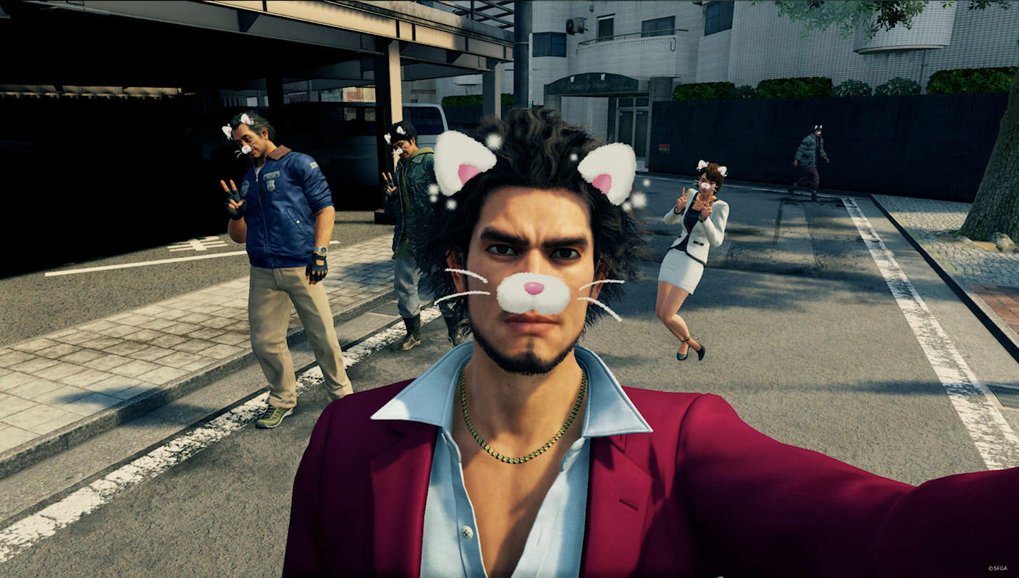 The friends in Yakuza: Like a Dragon pose for a selfie.