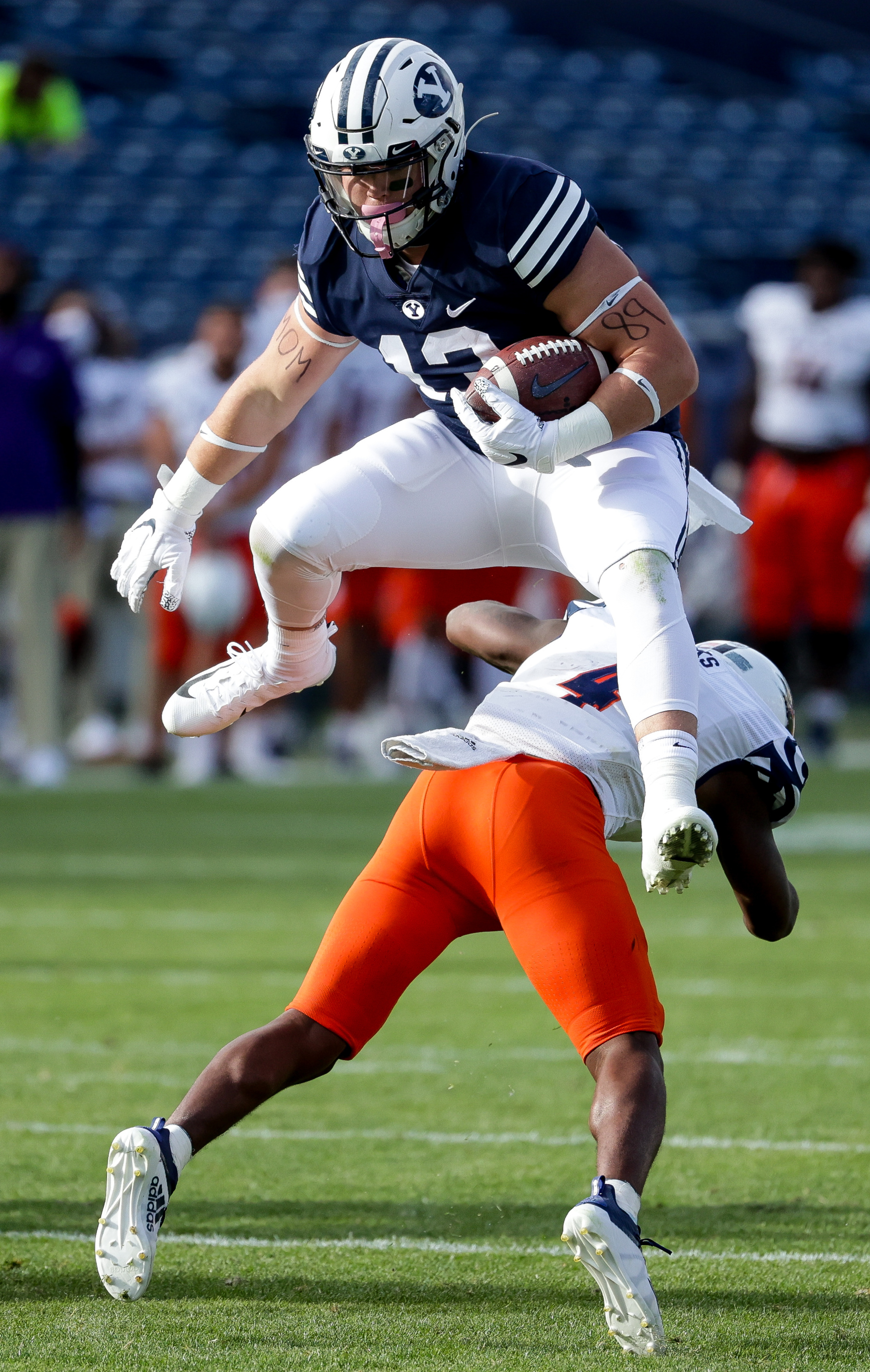 Brigham Young Cougars tight end Masen Wake (13) leaps over UTSA Roadrunners safety Antonio Parks (4), but the play is called back due to an offensive holding call, during the game at LaVell Edwards Stadium in Provo on Saturday, Oct. 10, 2020.