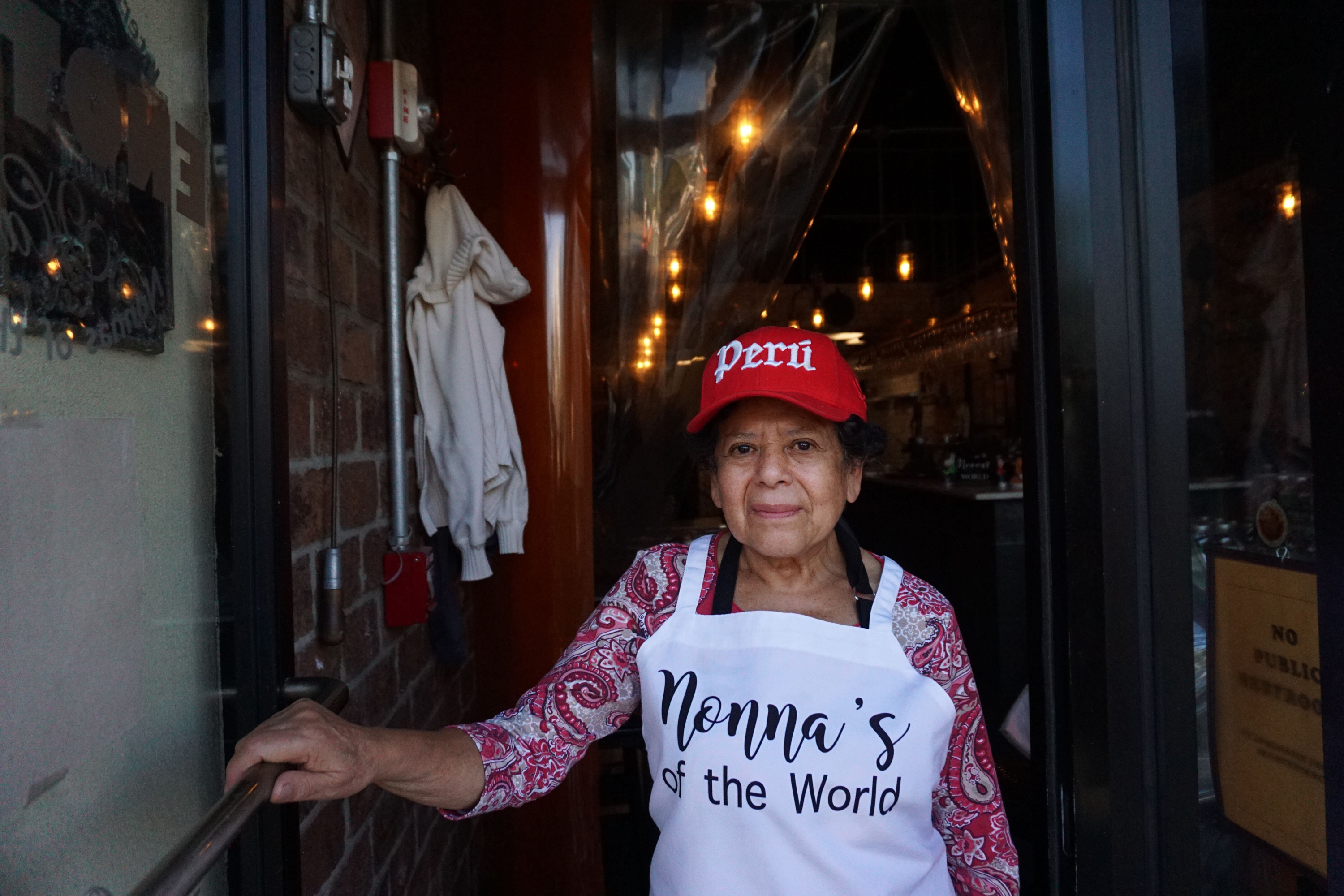 """Rosa Correa, a 77-year-old """"nonna"""" originally from Peru, stands outside Enoteca Maria after making sauces for the restaurant to sell, Oct. 9, 2020."""