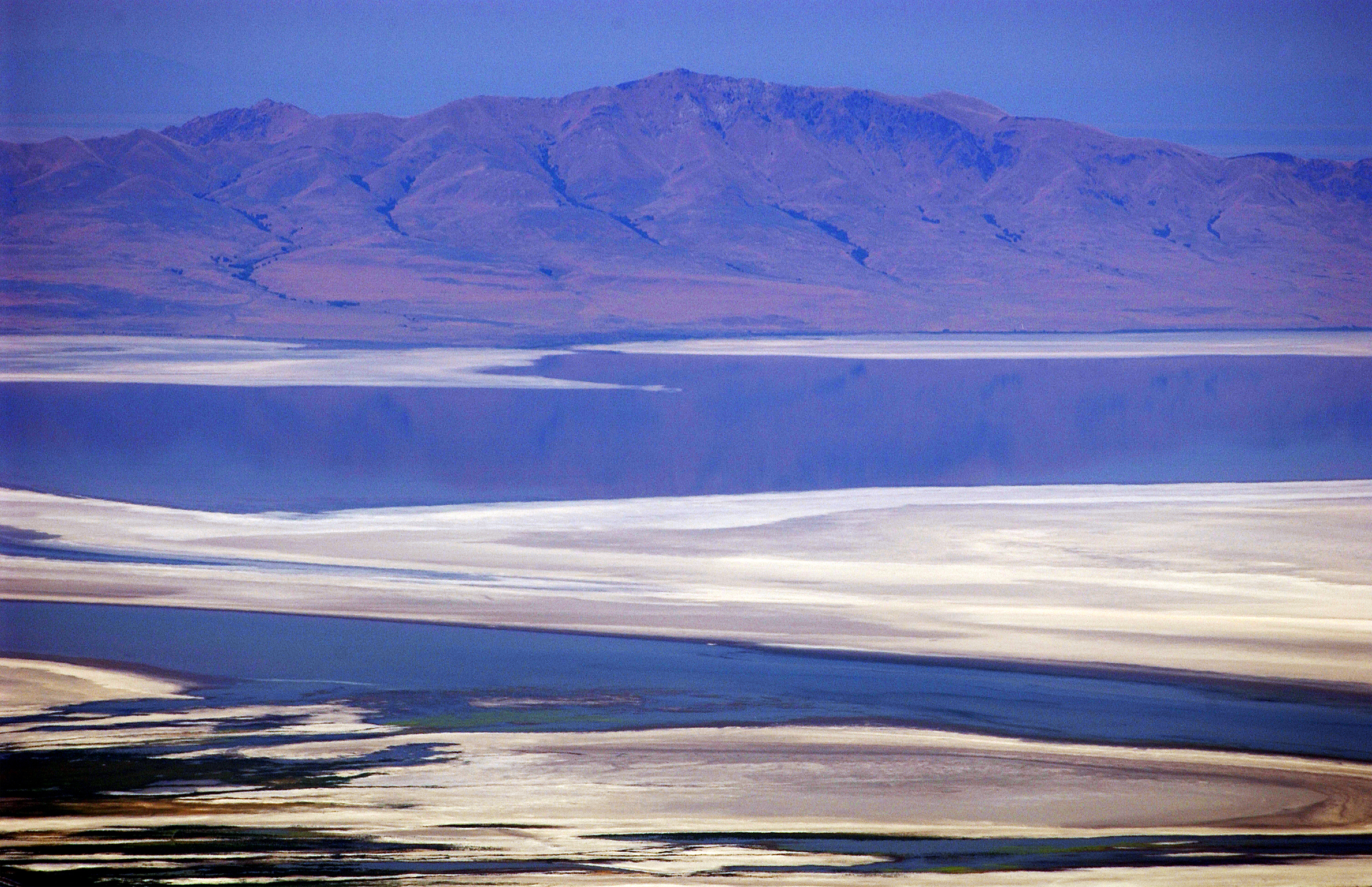 The low water of the Great Salt Lake shows with Antelope Island in the background. This photo is taken from Skyline Drive above Bountiful. photo by Ravell Call (Submission date: 07/22/2003)