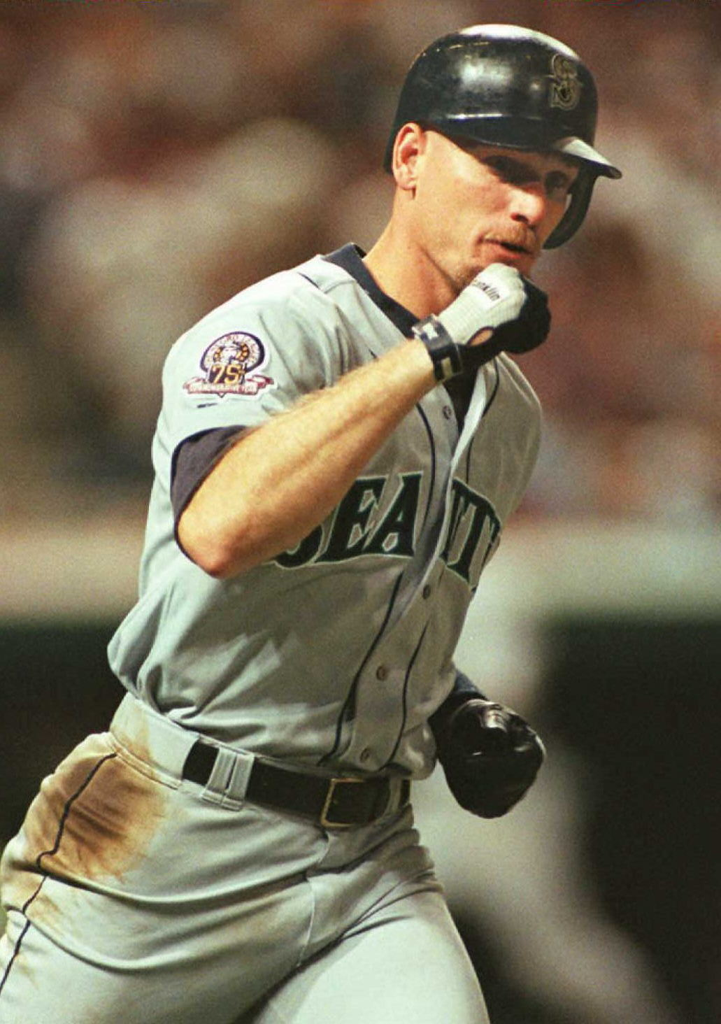 Seattle Mariners Jay Buhner pumps his fist as he r